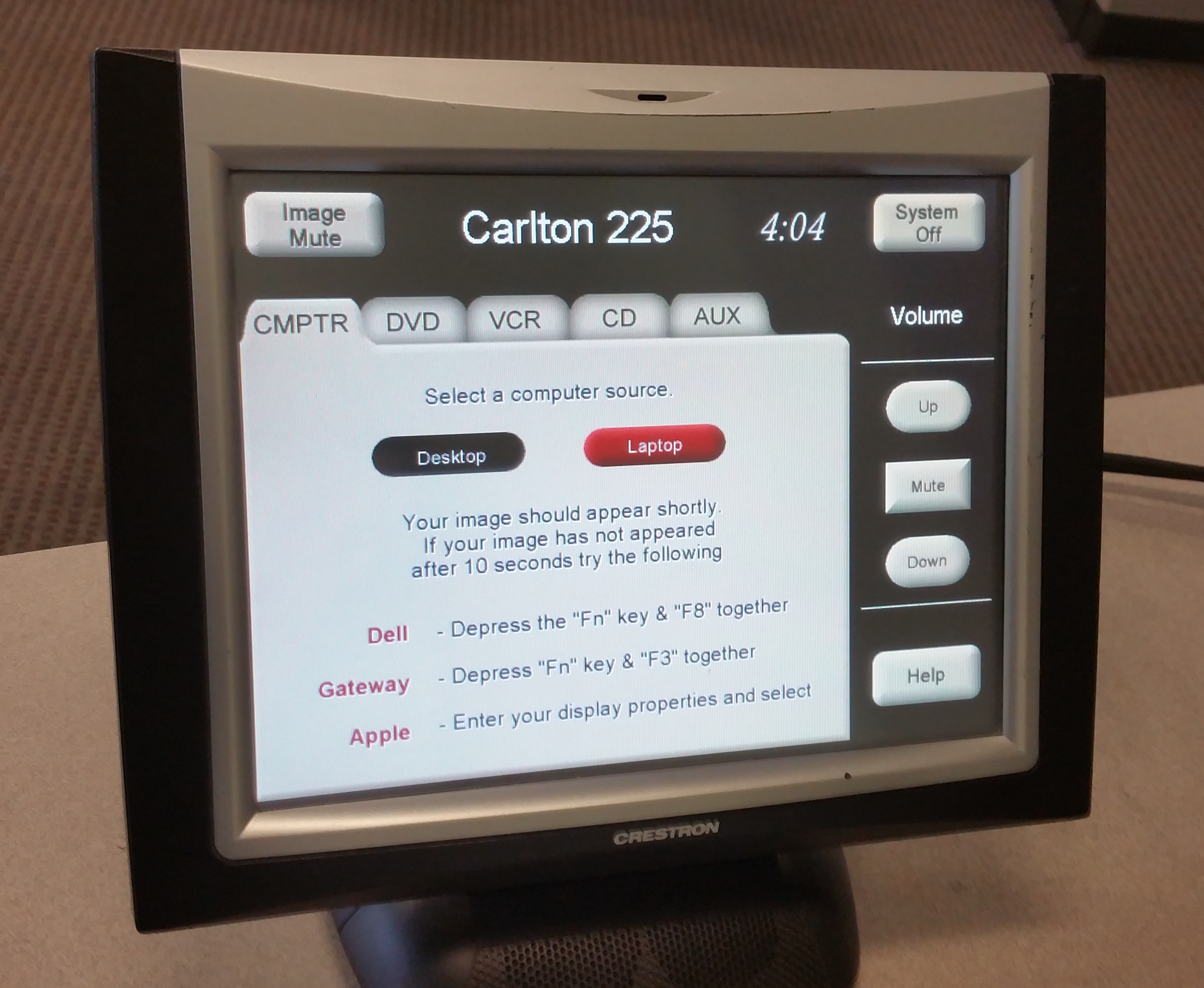 Photo of crestron control touch panel highlighting the computer tab option