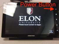 Photo of crestron touch screen control panel with power button notation