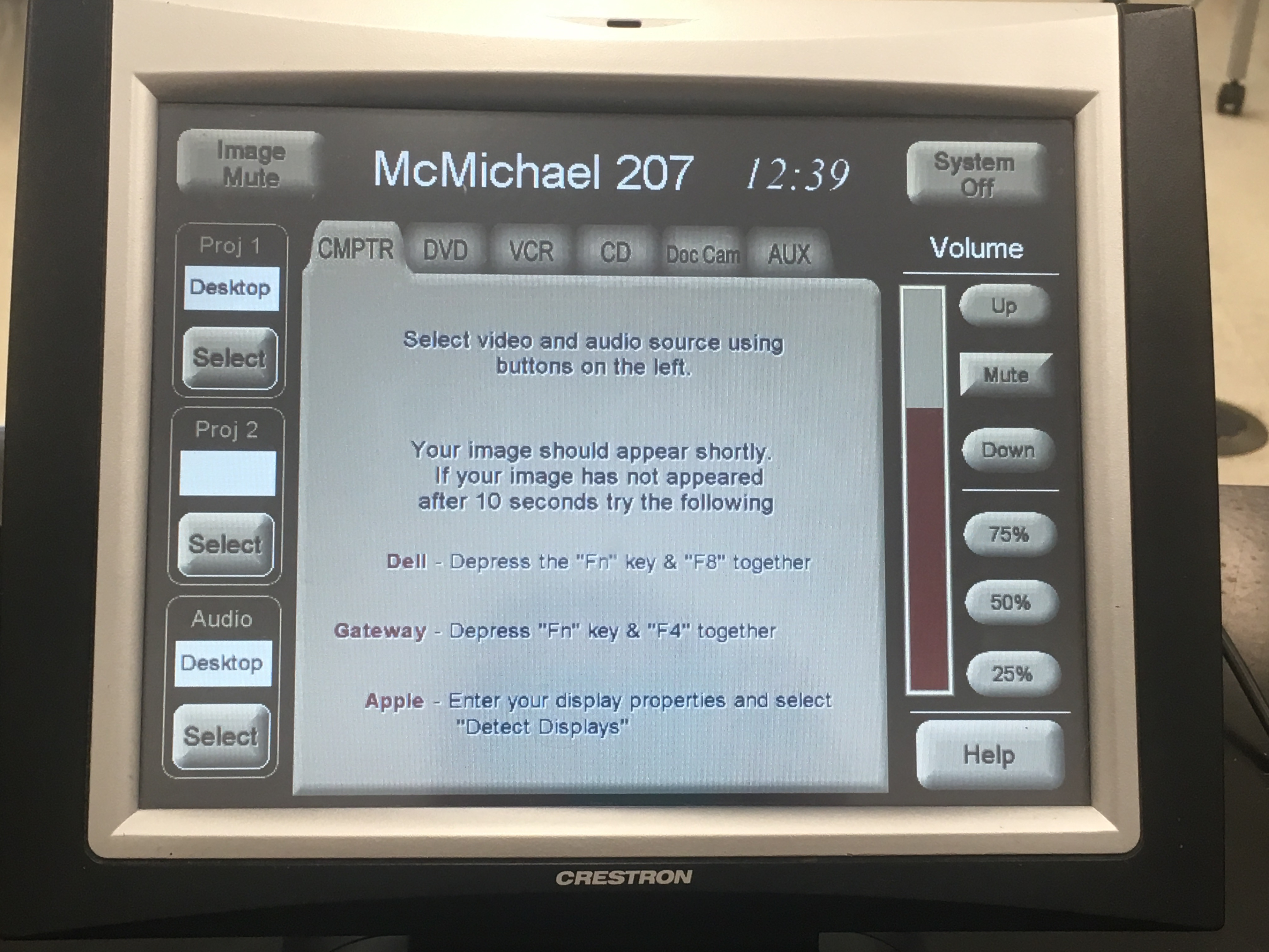 Photo of the crestron control touch system with the computer tab active