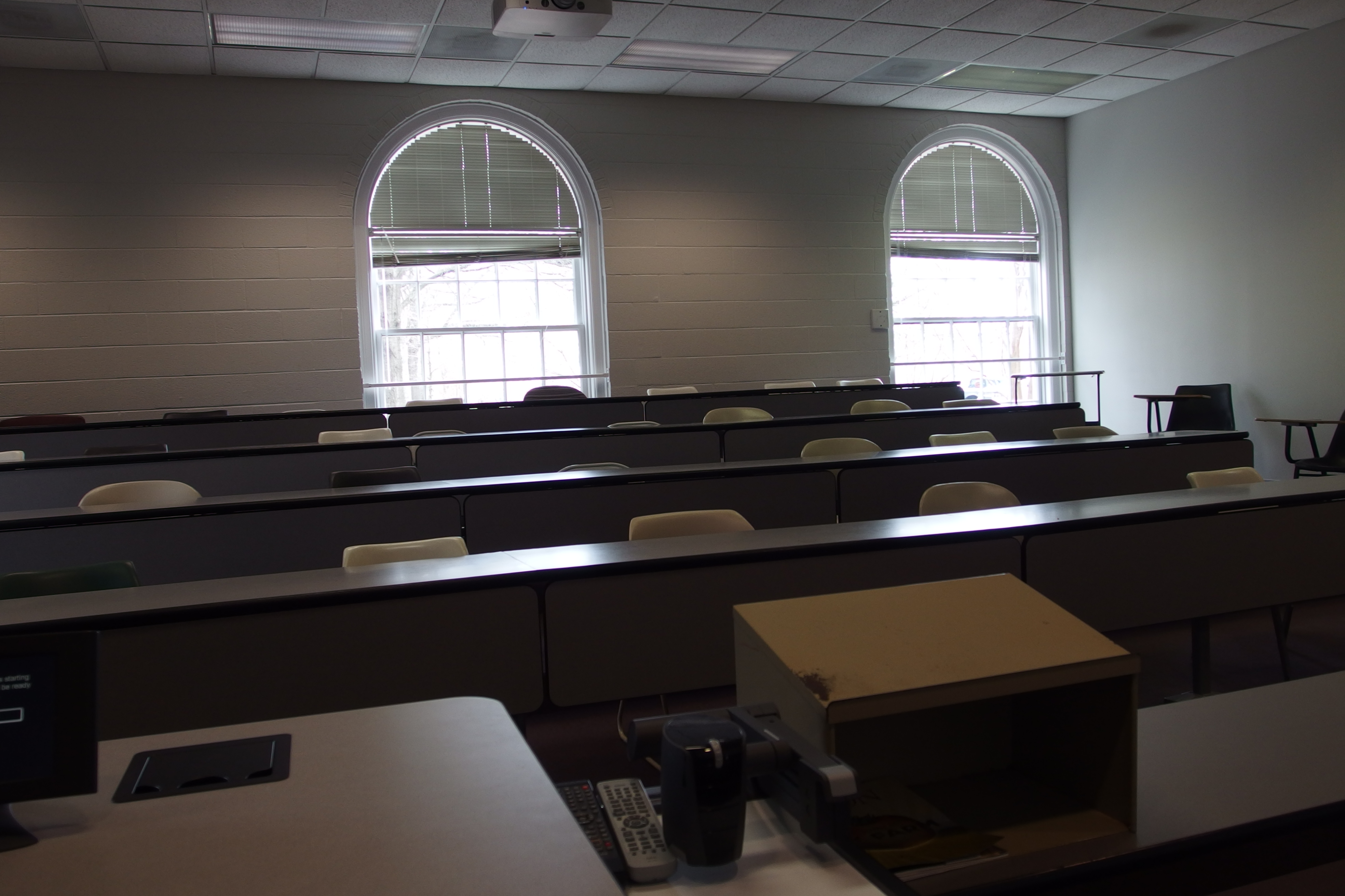 Photo of the classroom taken from the instructor's station looking at the student desks