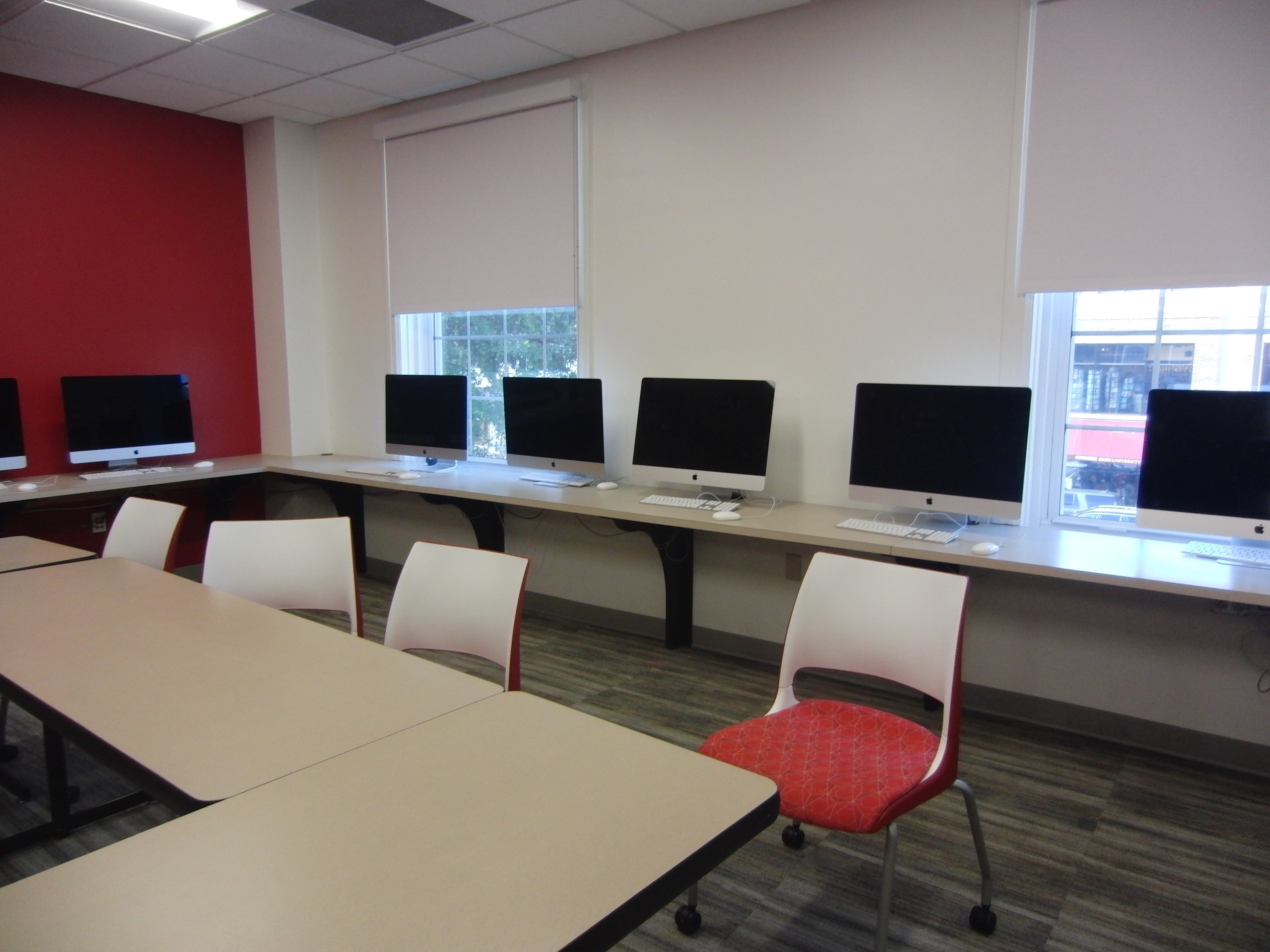 Photo of the classroom space showing the iMacs against the wall and mobile furniture