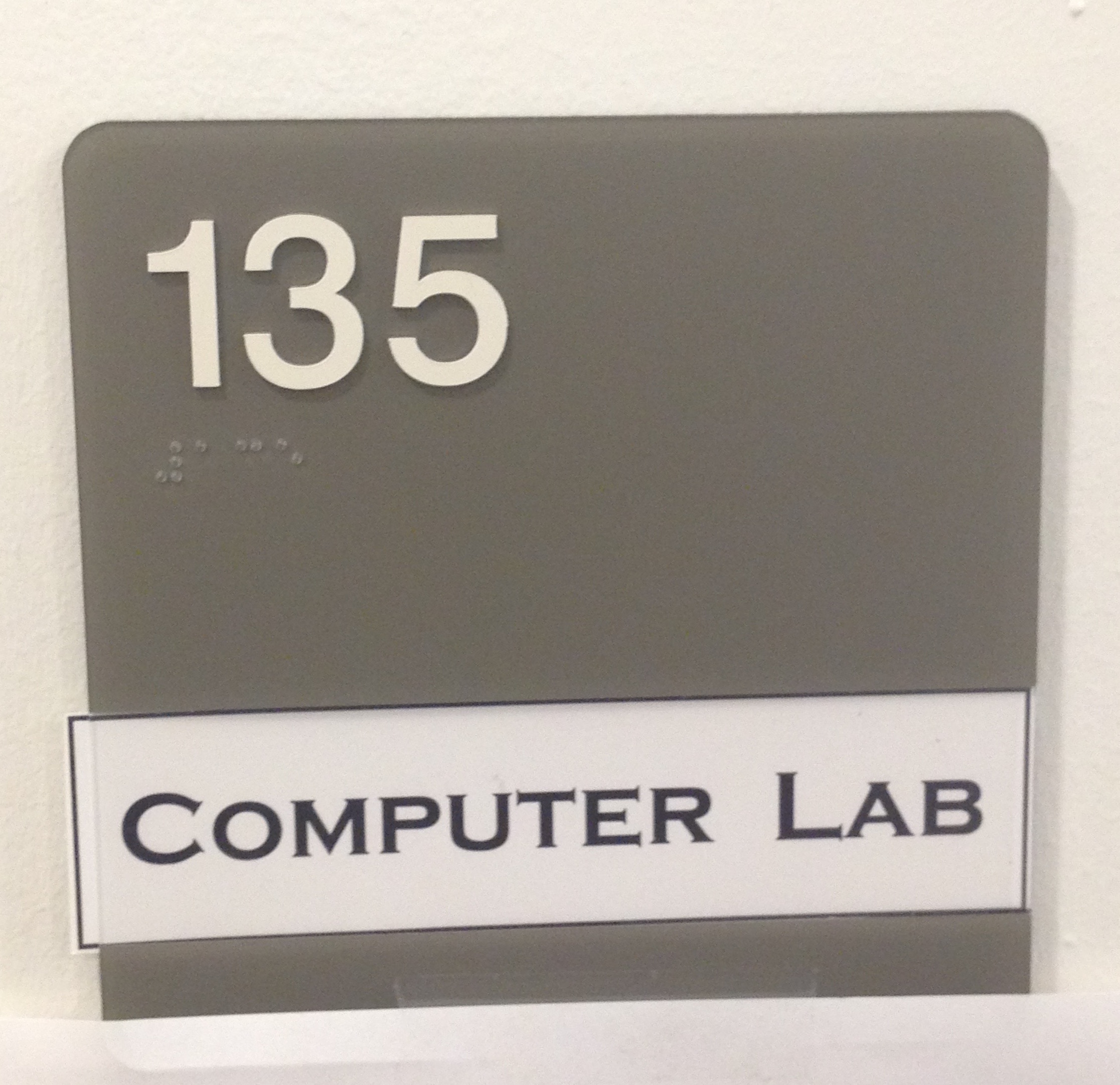 A picture of the sign for room #135.