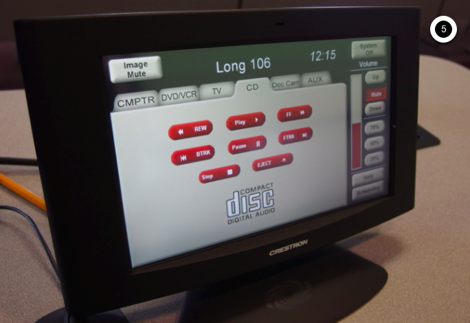 Photo of crestron control touch panel with CD tab active