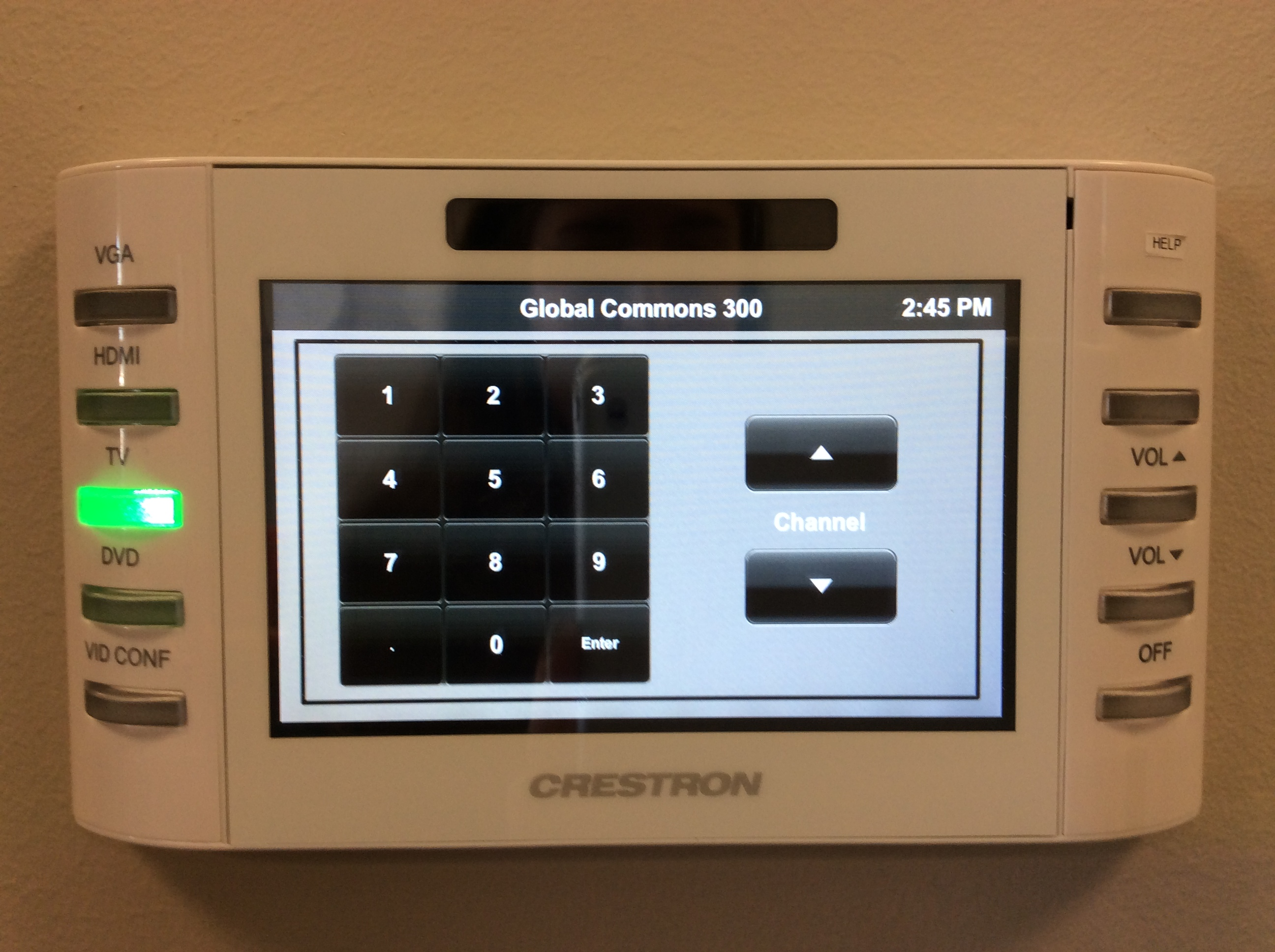 Photo of crestron control touch panel with tv option active