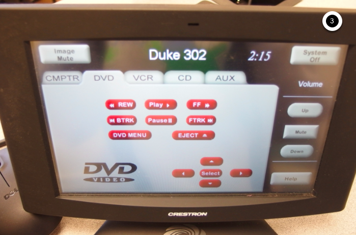Photo of crestron control touch panel with DVD tab active