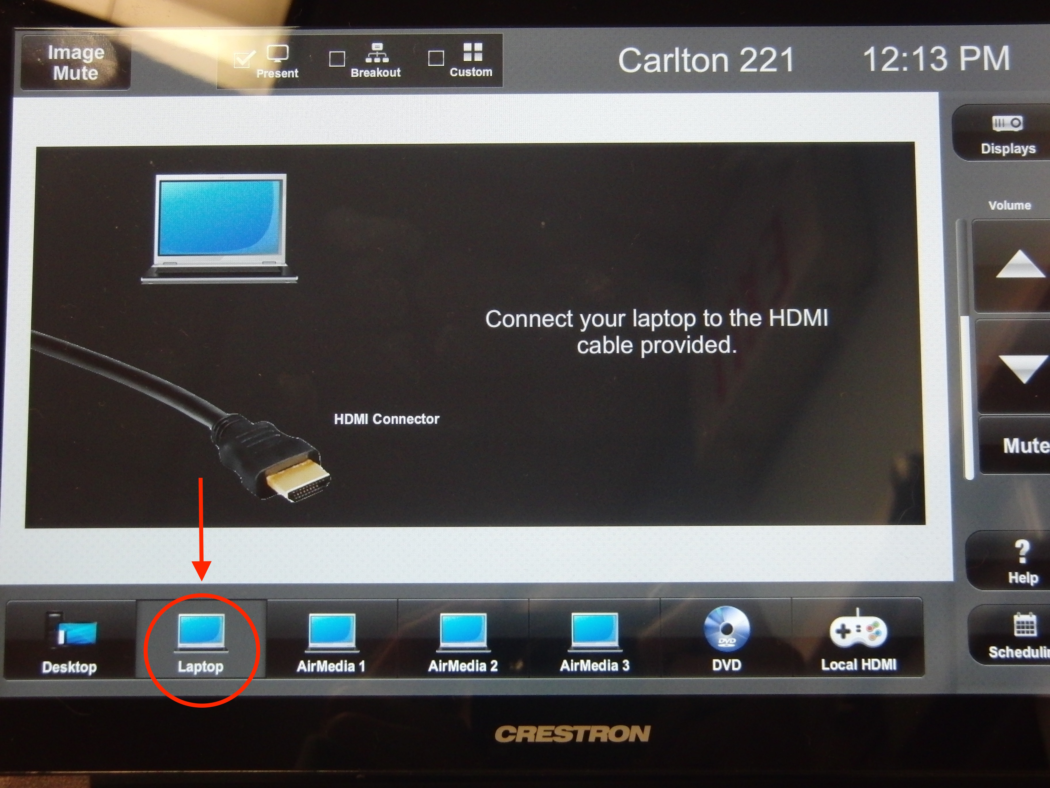 Photo of crestron control touch panel highlighting the laptop option