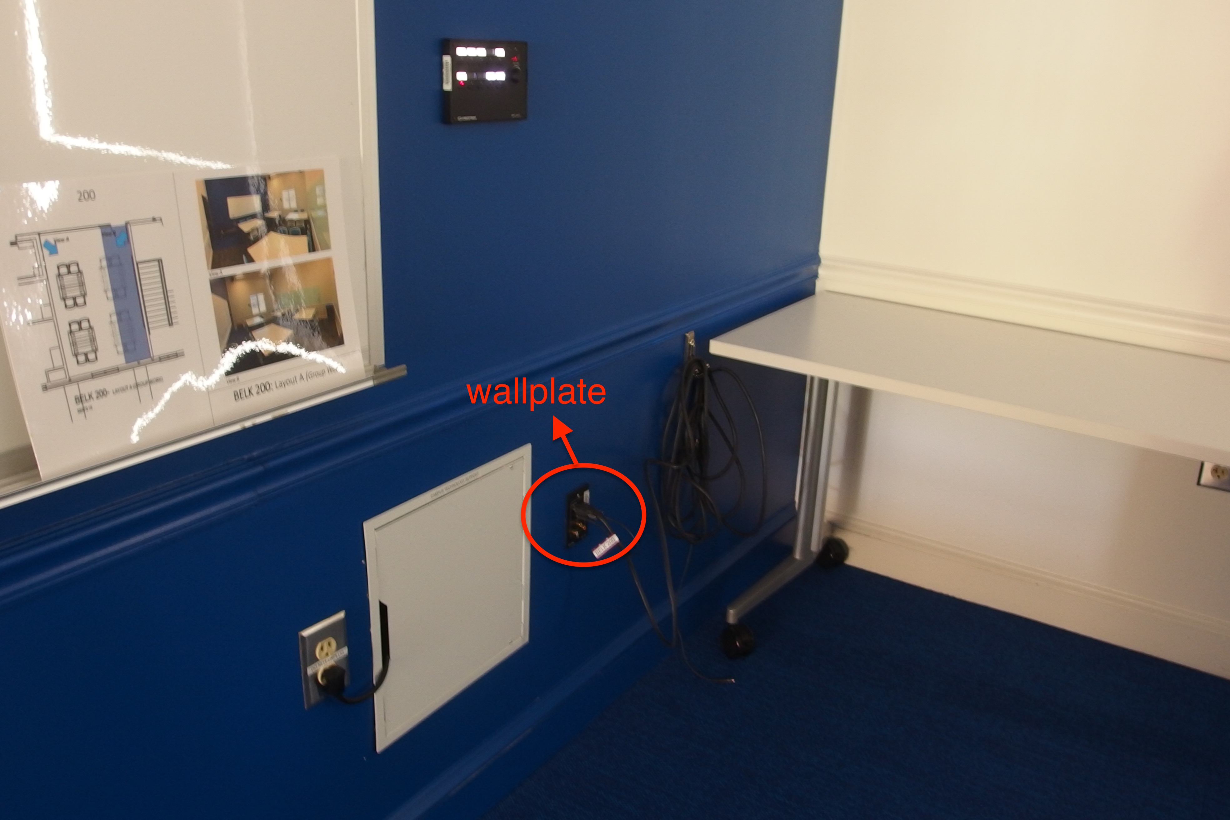 A photo of the wall plate in the lower left hand corner of the room.