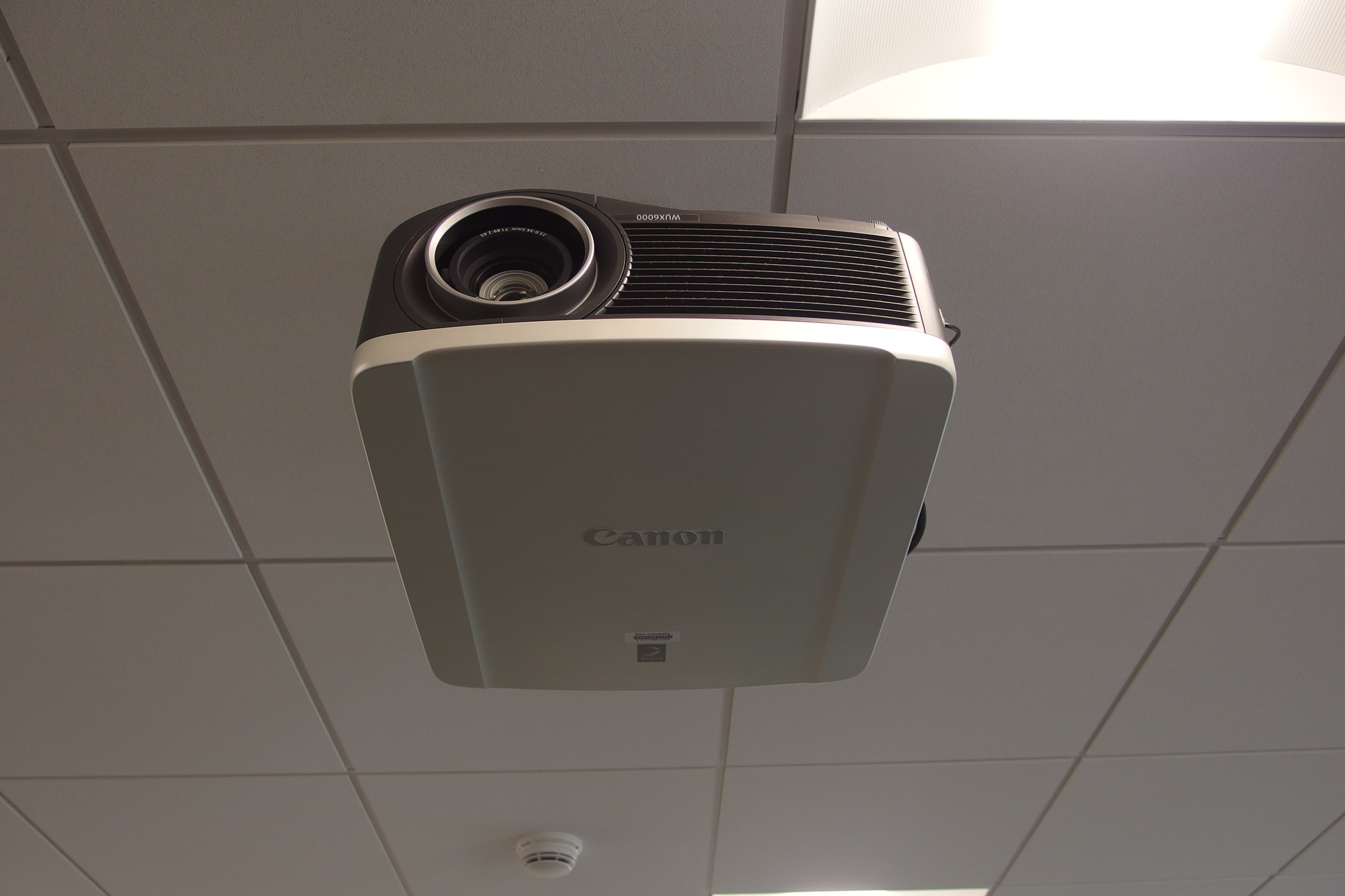 A photo of a projector on the ceiling.