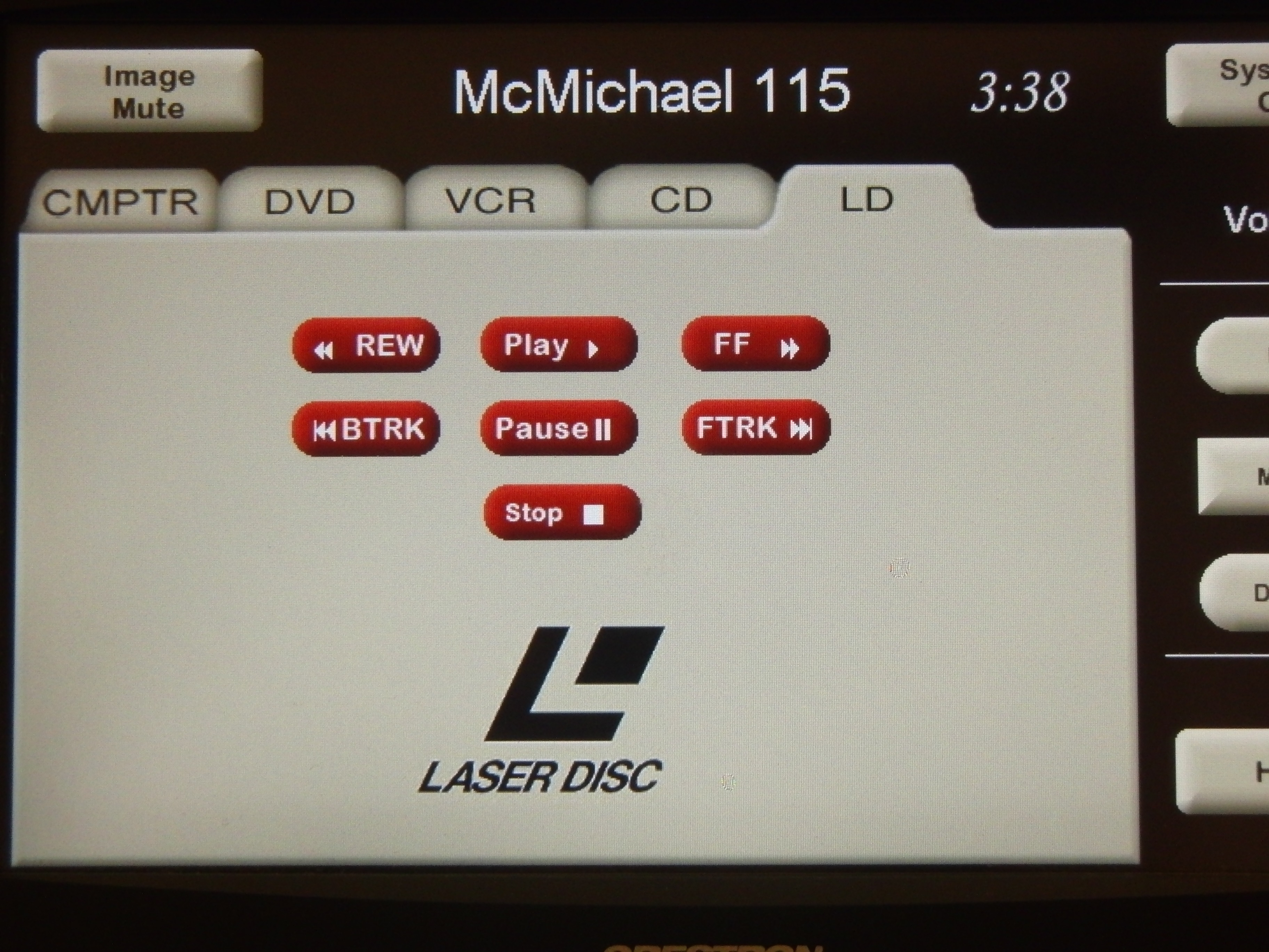 Photo of crestron control touch panel with the laser disk tab active