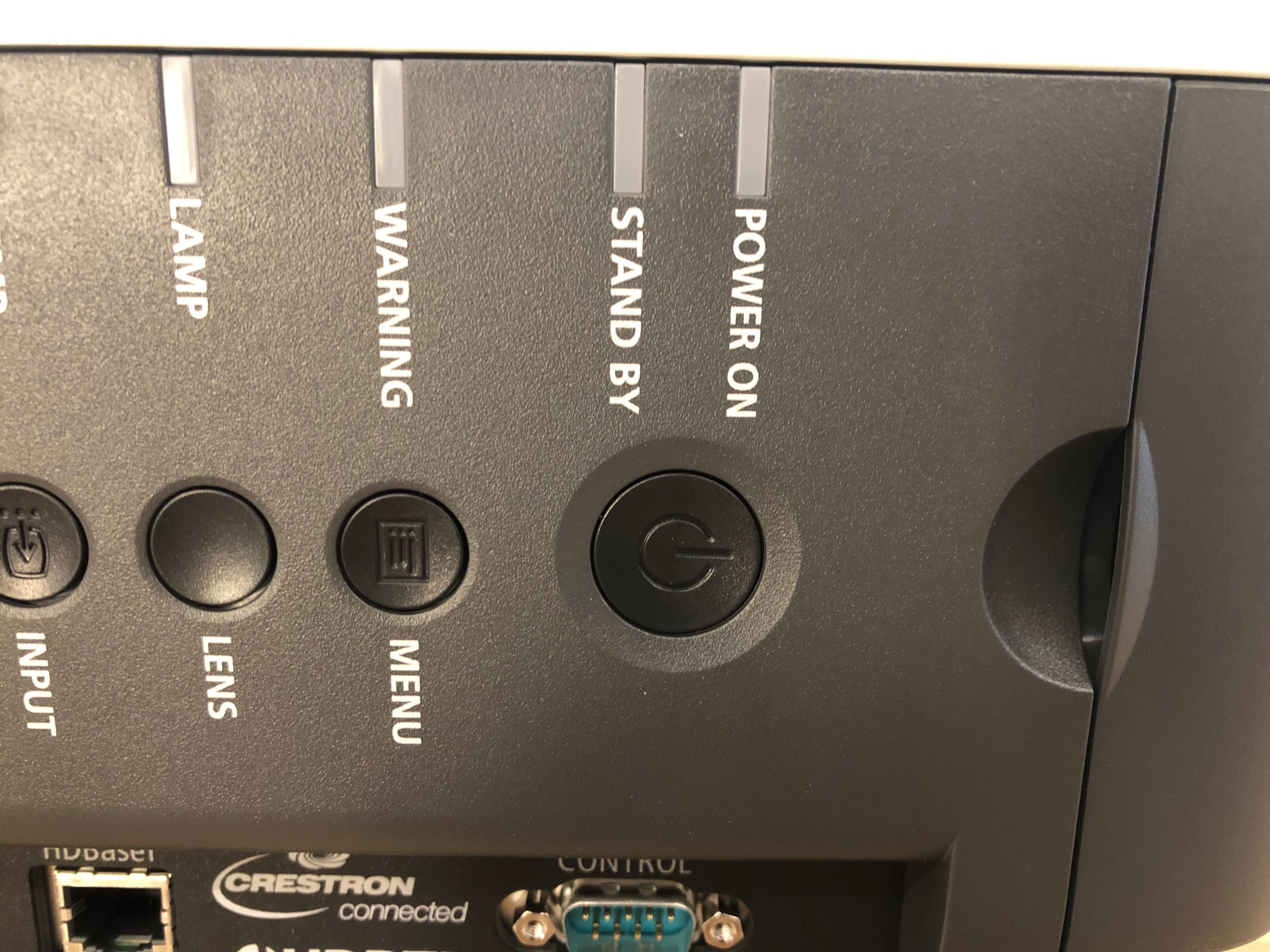 A photo of the power button on the projector.