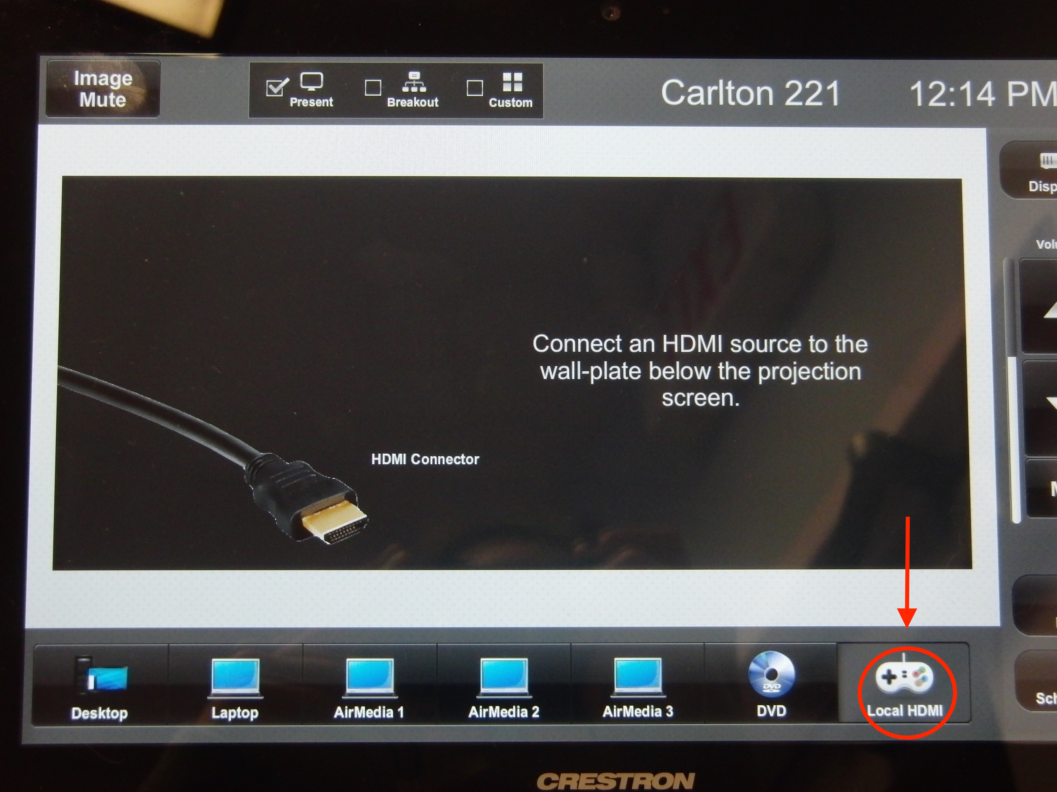 Photo of crestron control touch panel highlighting the HDMI gaming console