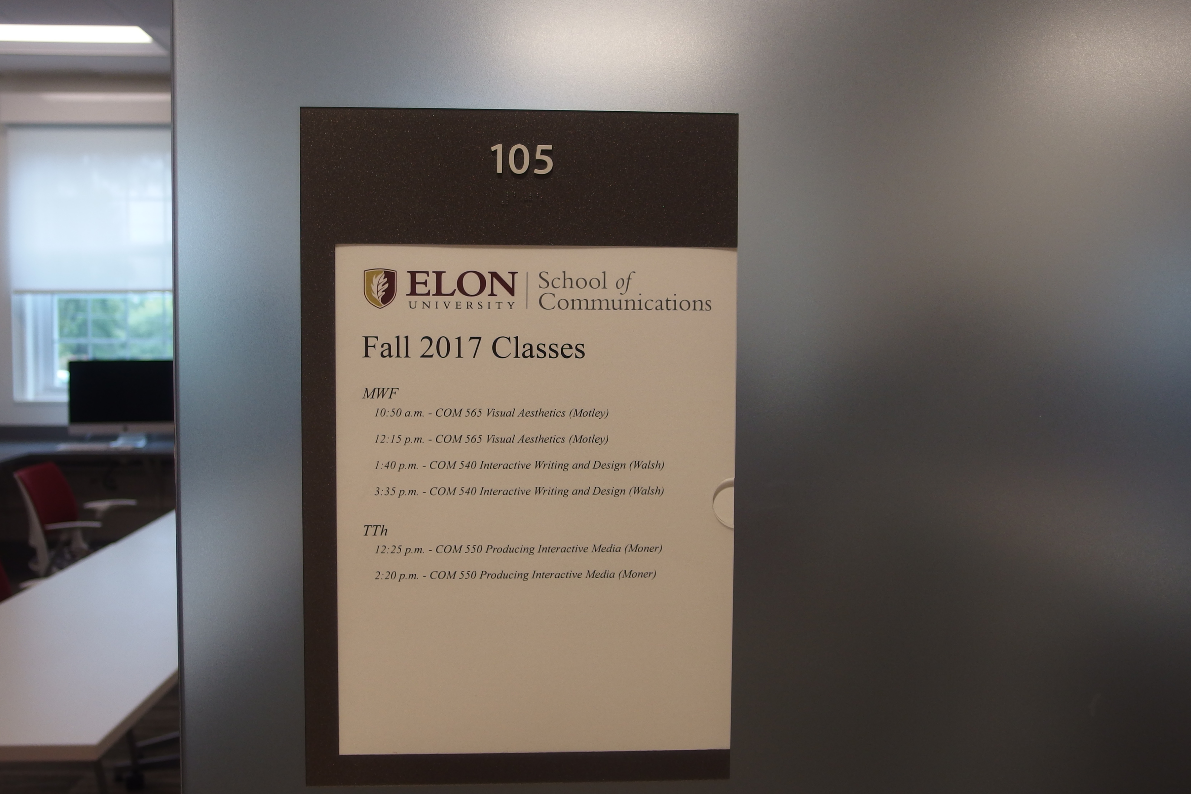 Photo of Long 105 room number with room schedule information below