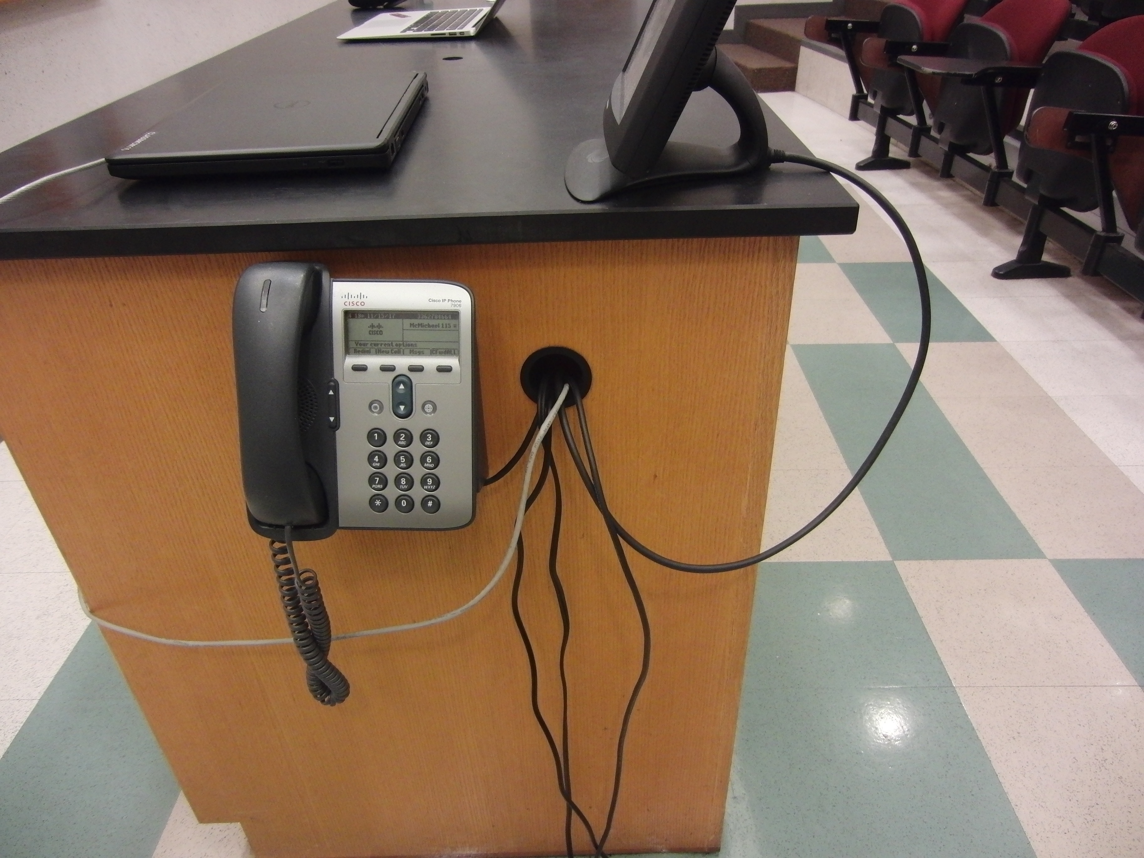 Photo of the locations for the cables available at the instructor's station and the classroom phone that is also available at the station