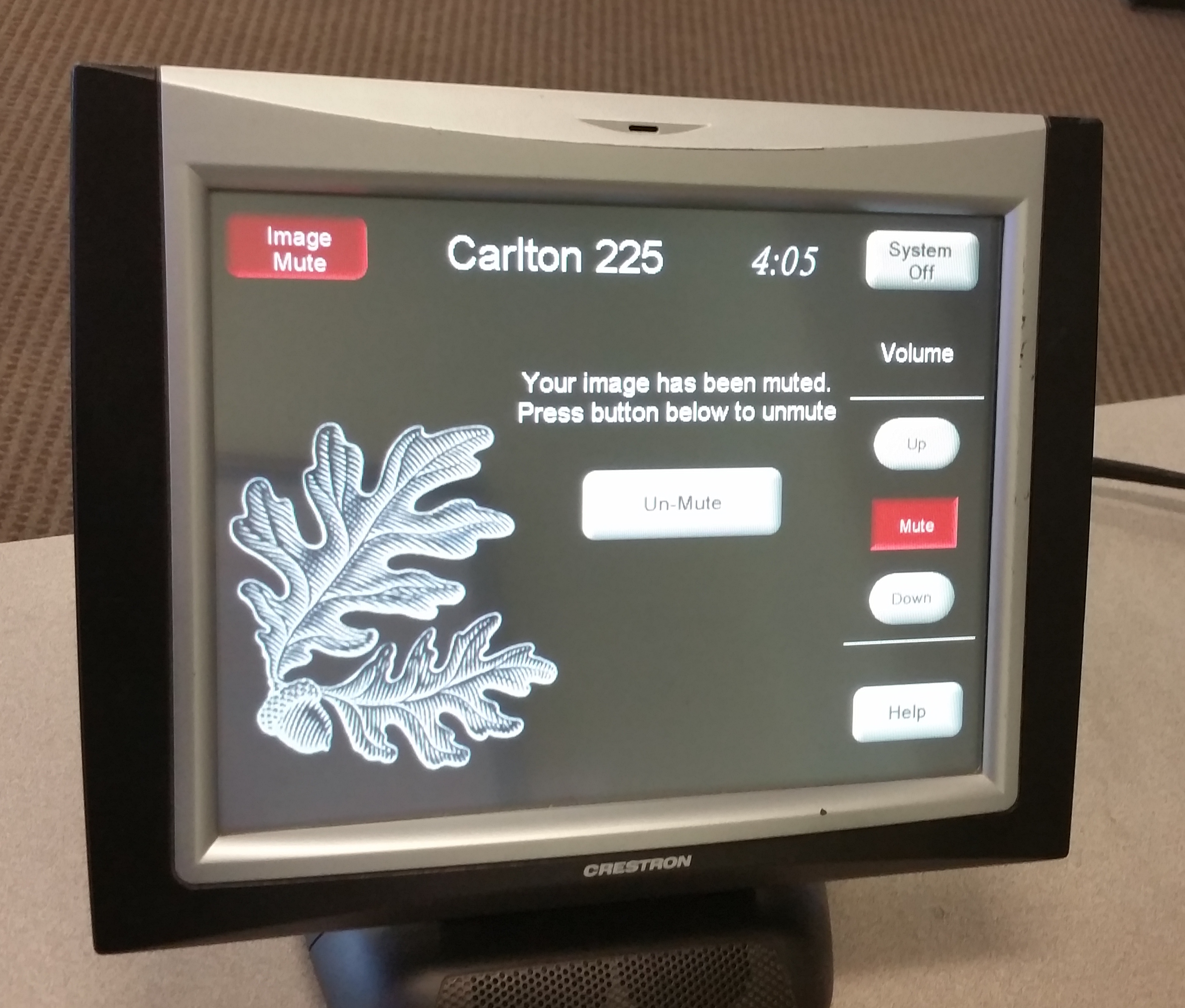 Photo of crestron control touch panel showing the image mute screen