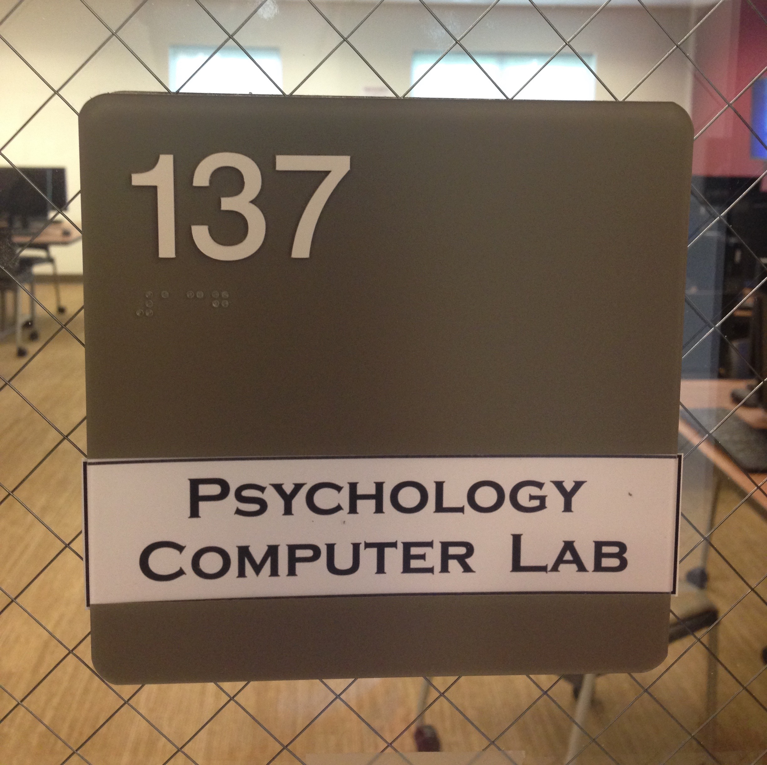 A picture of the sign for room #137.