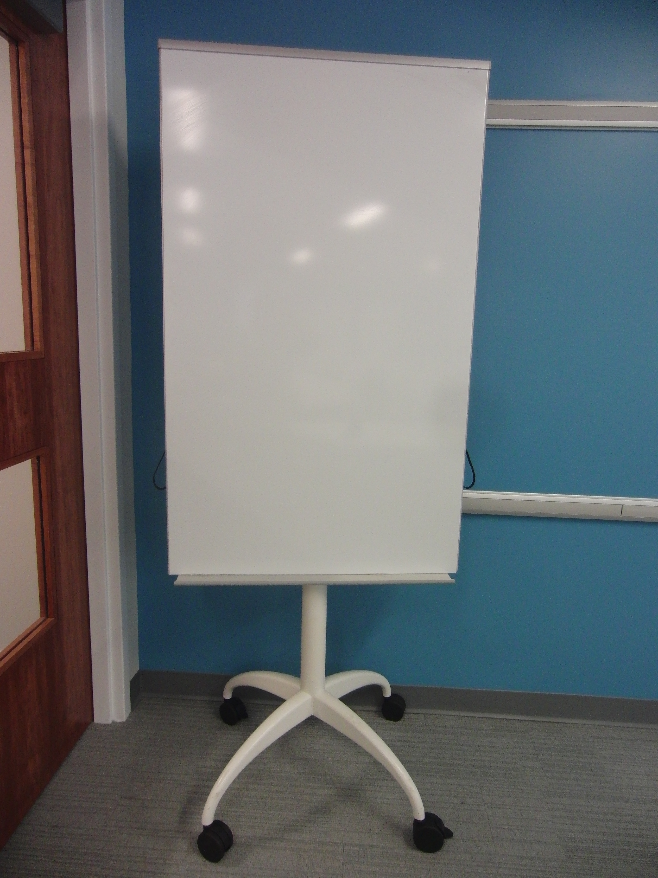 Photo of moveable white board on a rolling stand