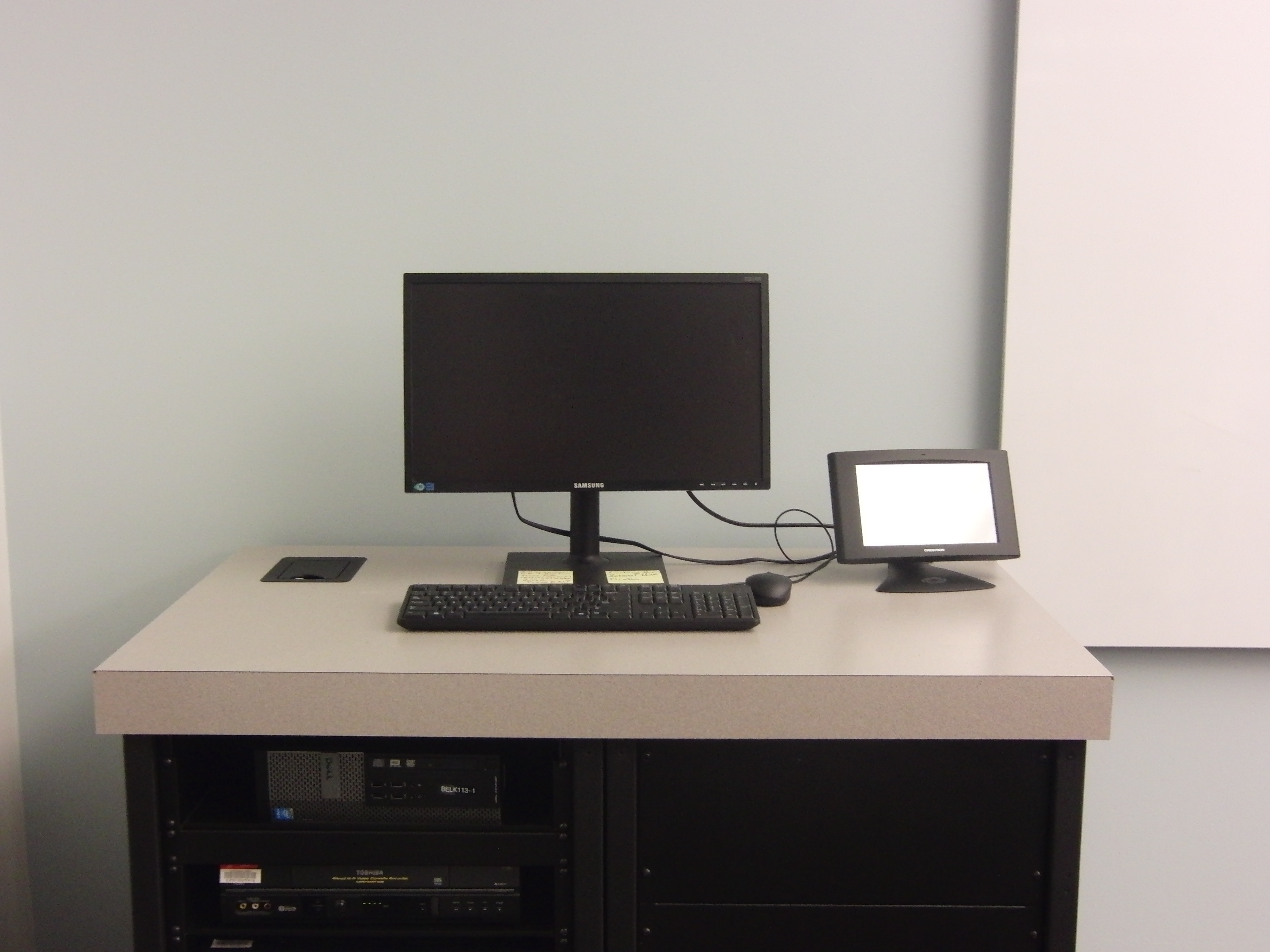 A photo of the desktop computer and the touch panel control.