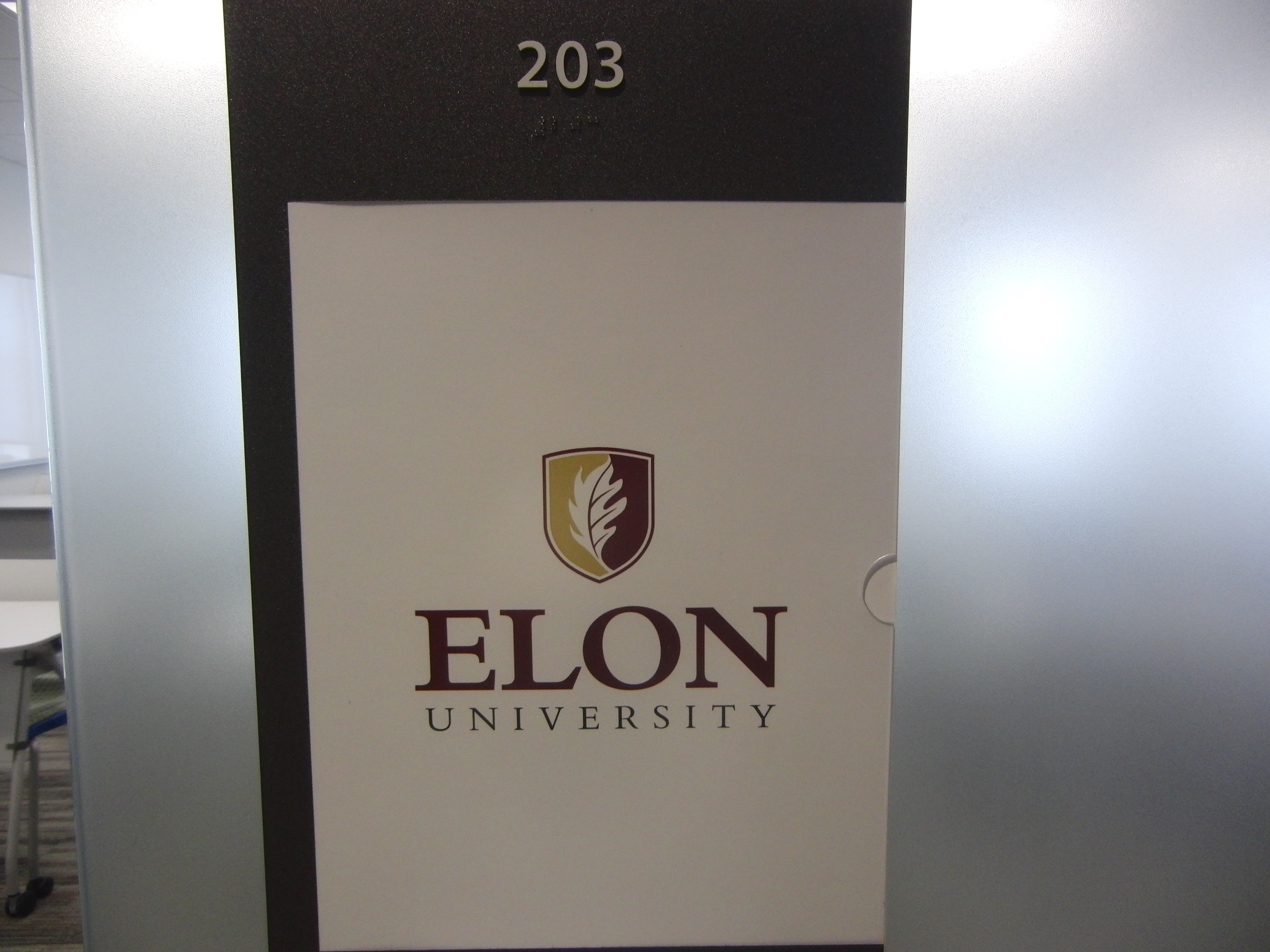 Photo of the Long 203 room number with classroom schedule listed below