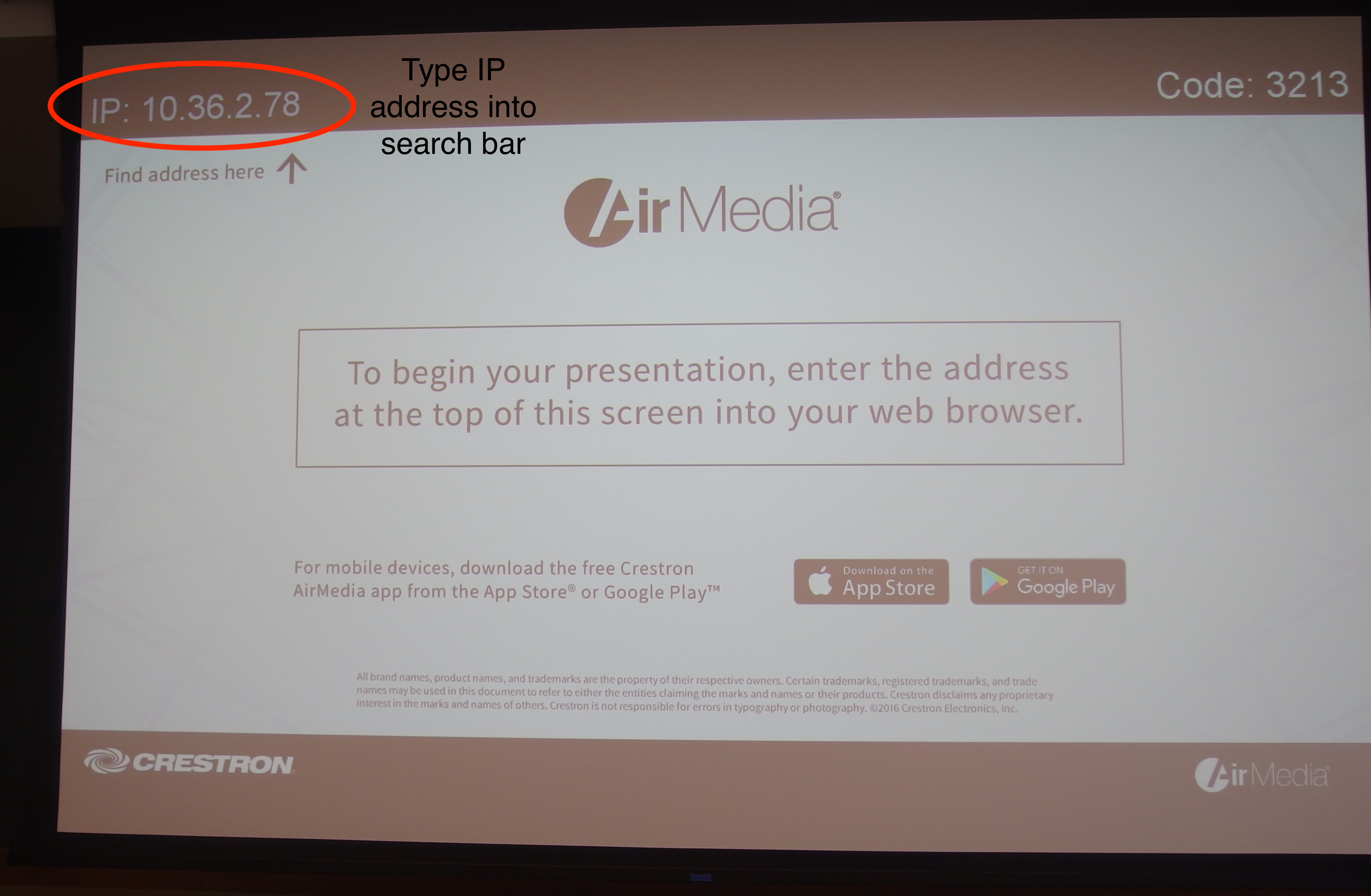 Picture of AirMedia IP address on projector screen.