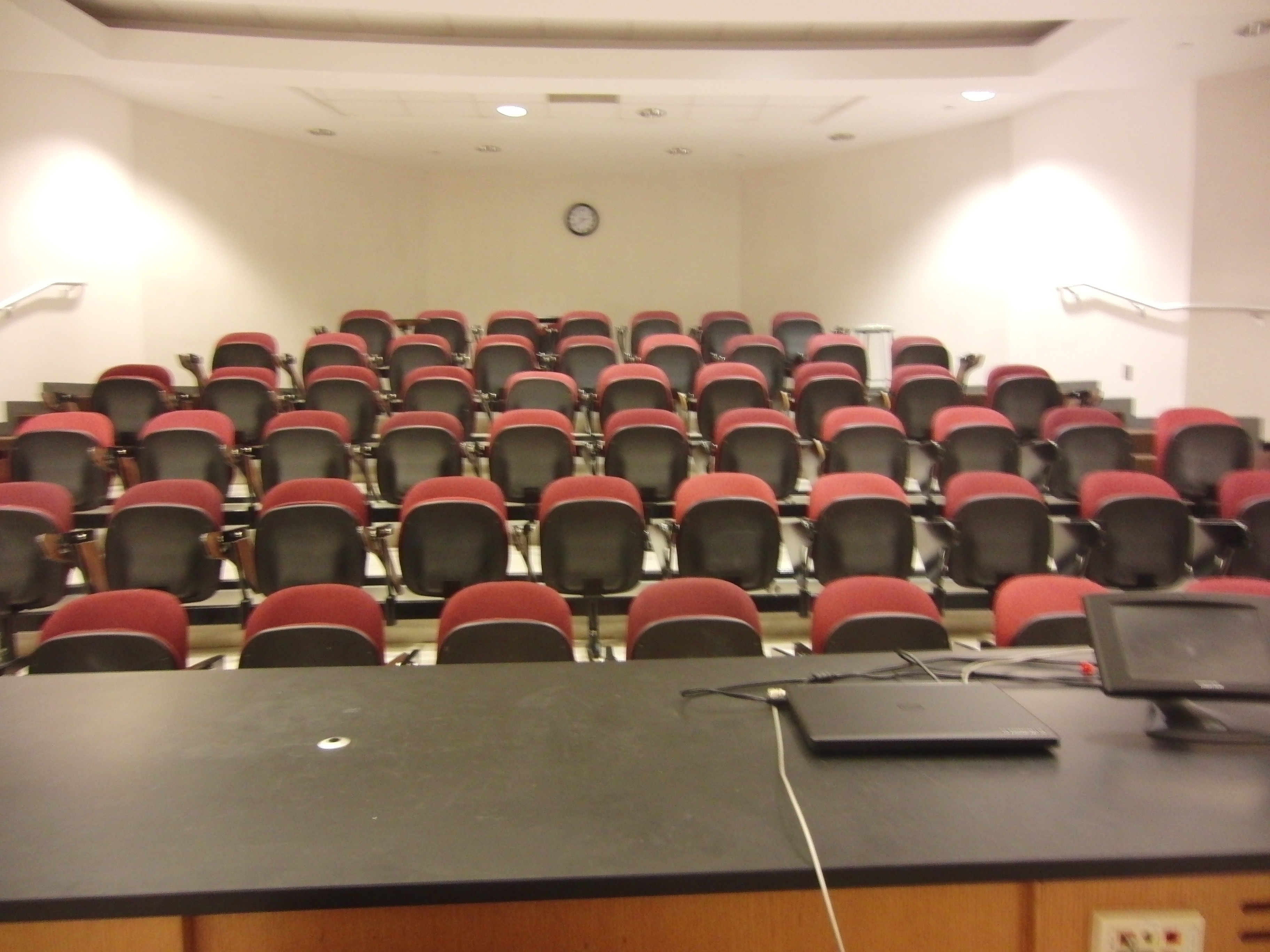 Photo of the lecture hall looking from the stage area out towards the seats