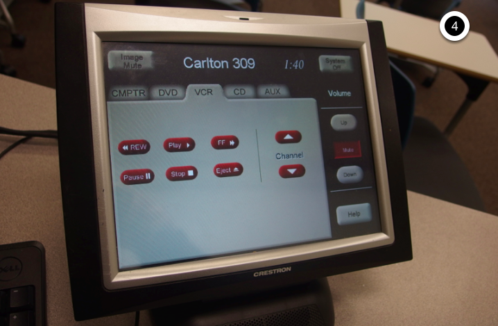 Photo of crestron control touch panel with VCR tab active