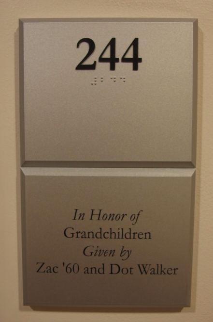 Photo of Koury Business 244 room number with dedication plaque below