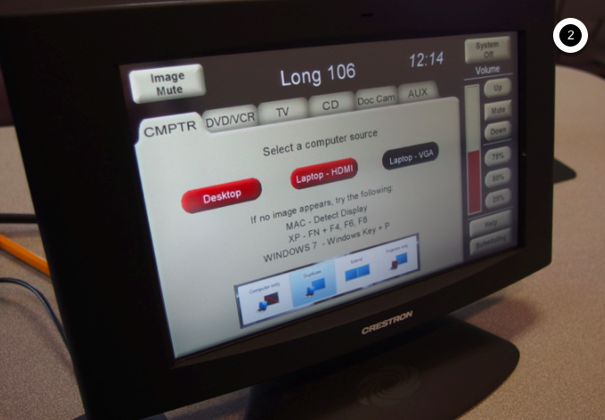 Photo of crestron control touch panel with computer tab active