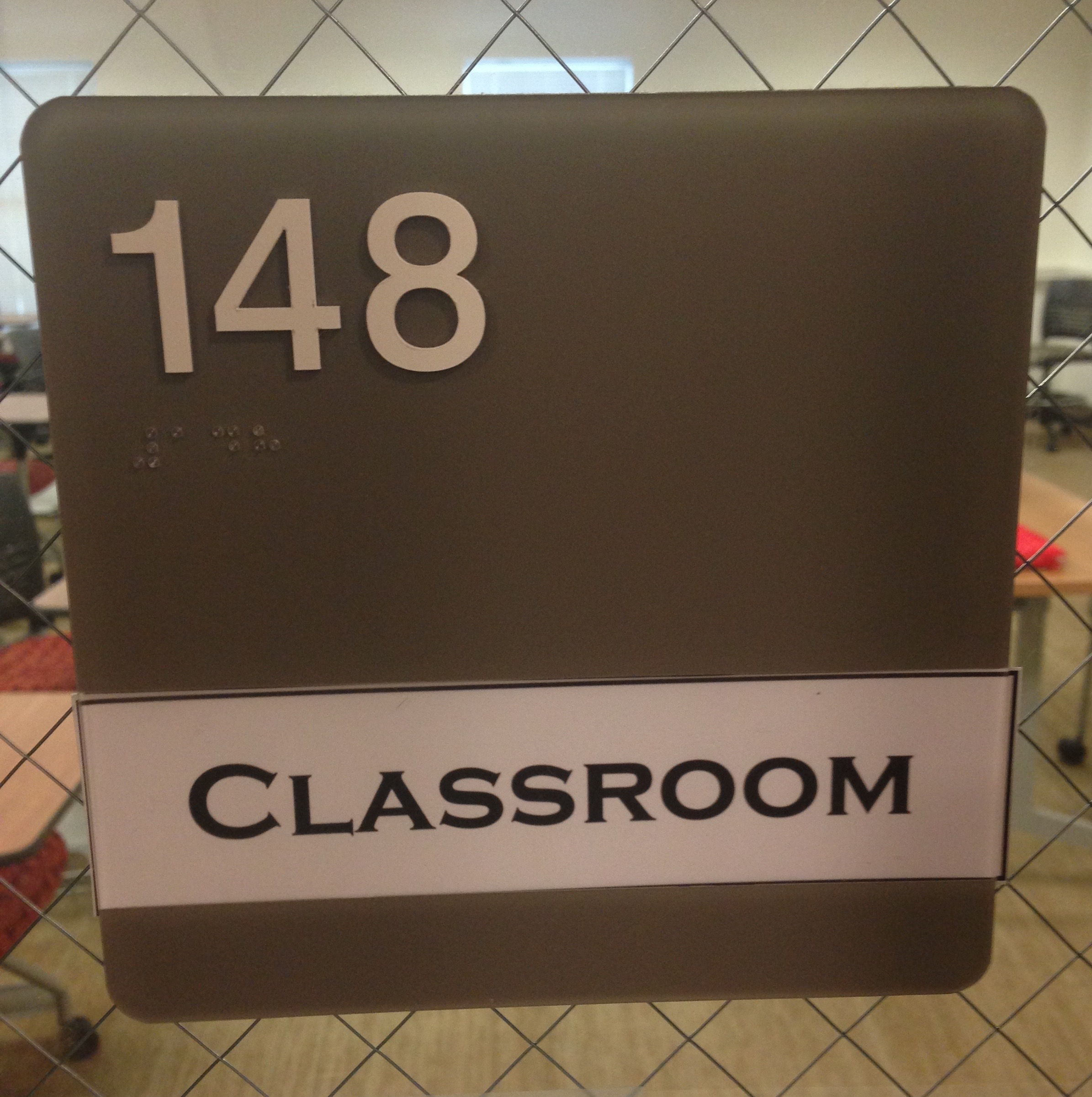 A picture of the sign for room #148.