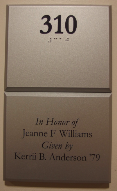 Photo of Koury Business center 310 room number with dedication plaque beneath