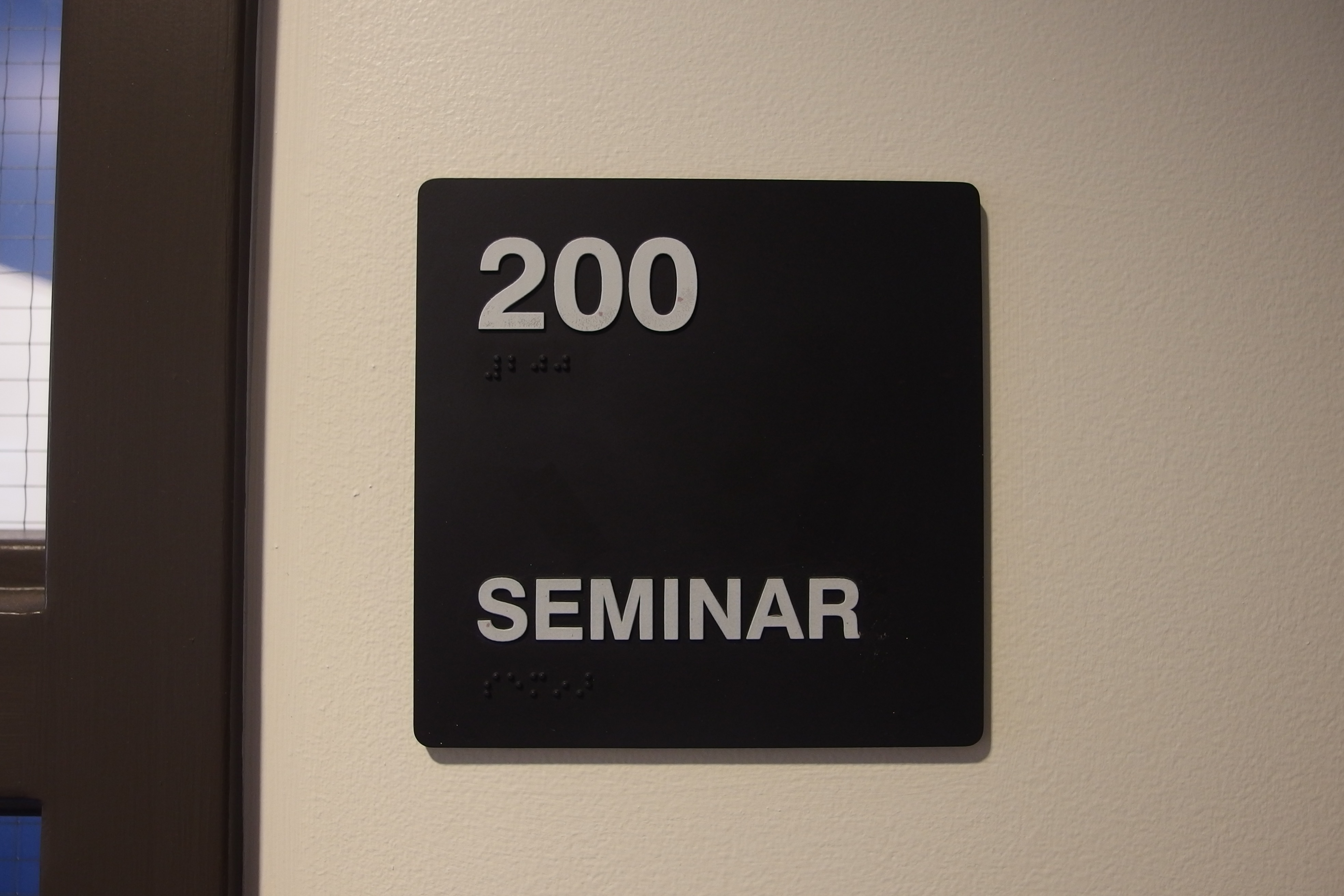 A photo of the sign of the room number.
