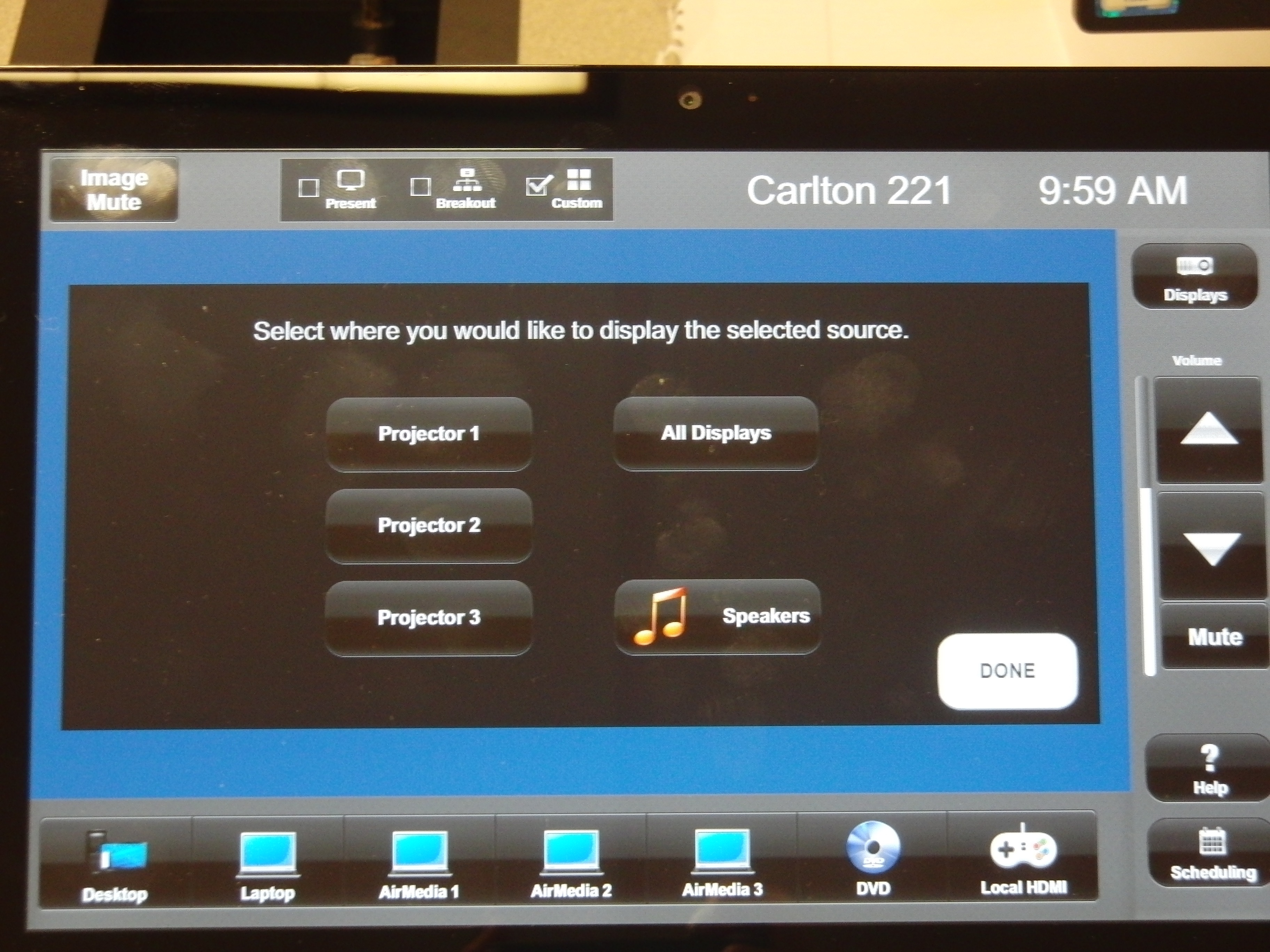 Photo of crestron control touch panel highlighting the custom option after a source has been chosen