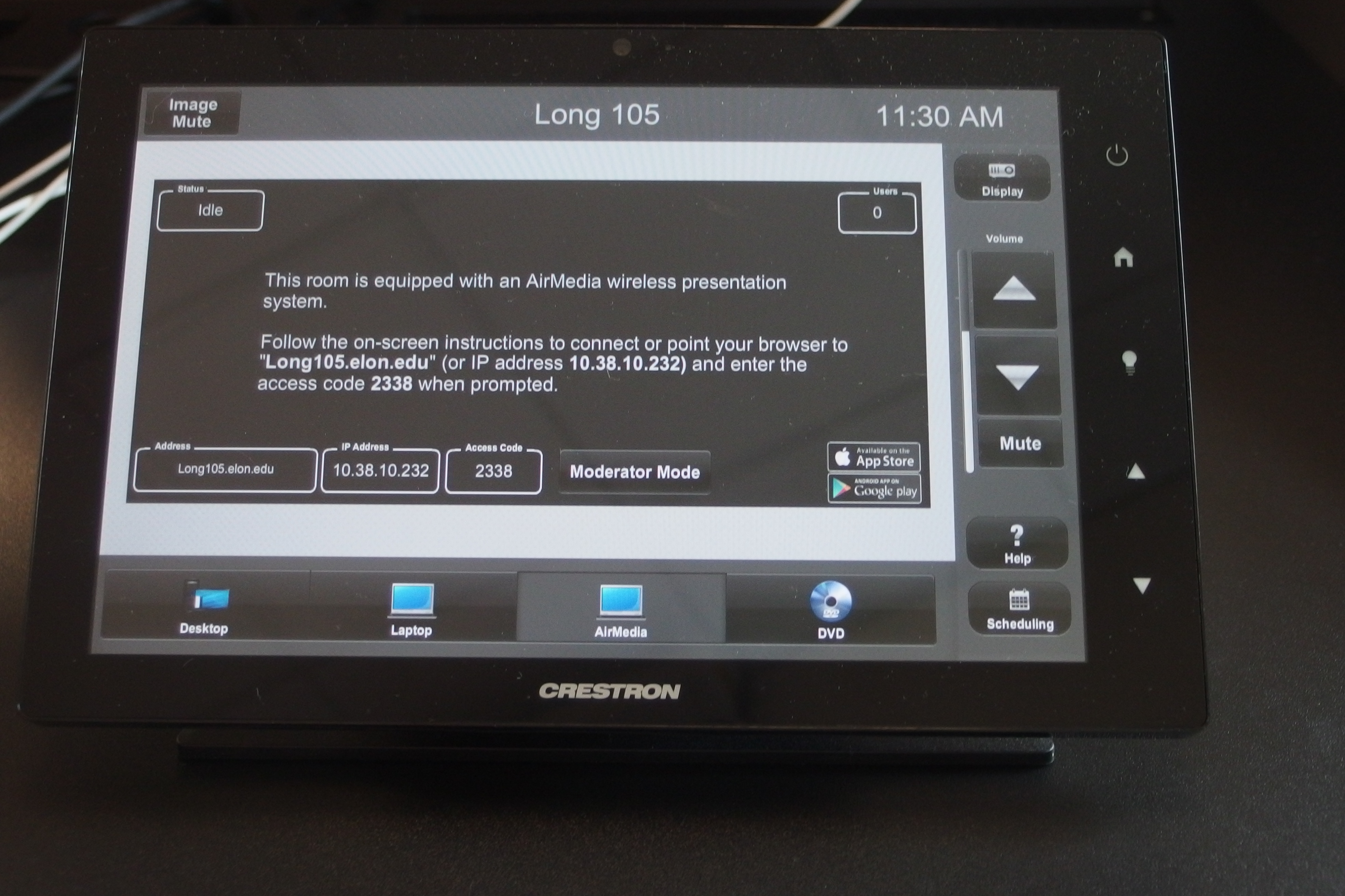 Photo of crestron control touch panel with the AirMedia tab active