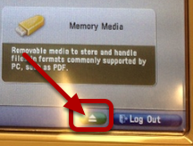 An image where the eject button is circled.