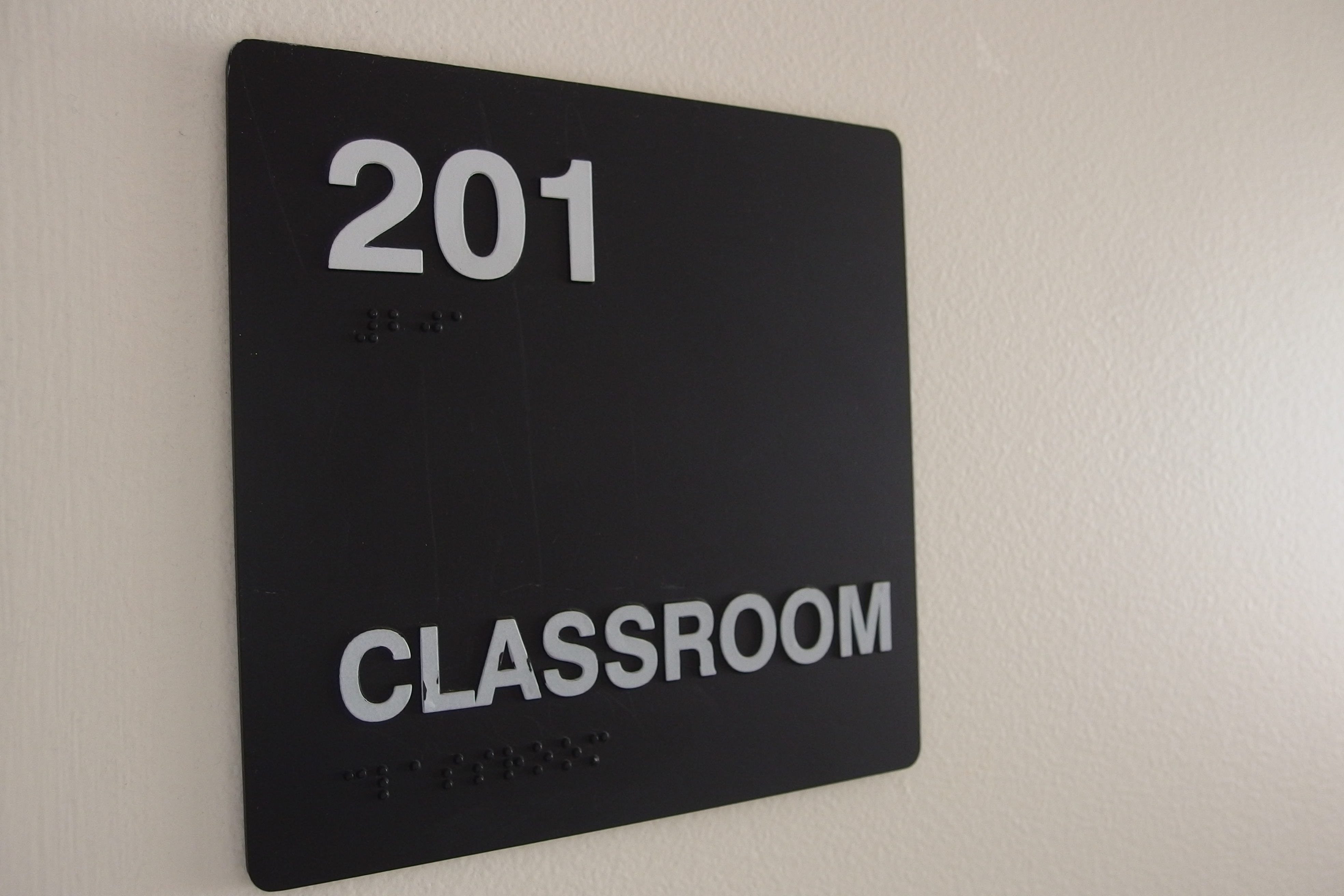 A picture of the sign for room #201.