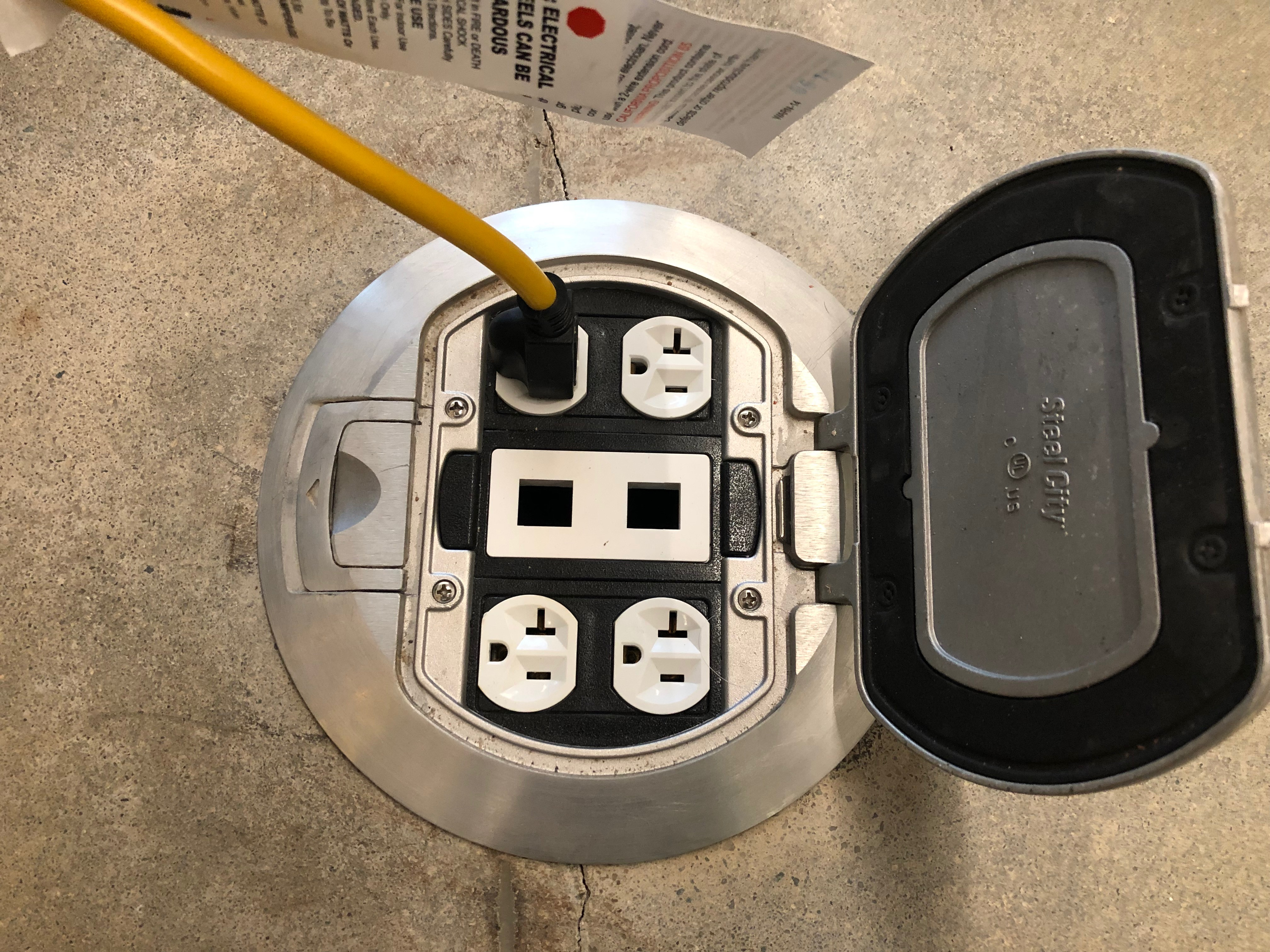 A picture of an extension cord plugged into a power outlet.