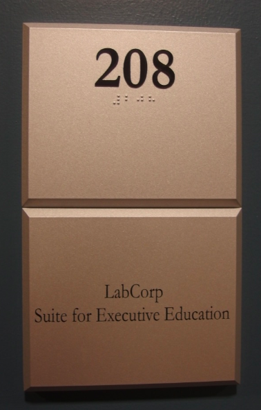 Photo of Koury Business Center 208 room number with LabCorp plaque located beneath the room number