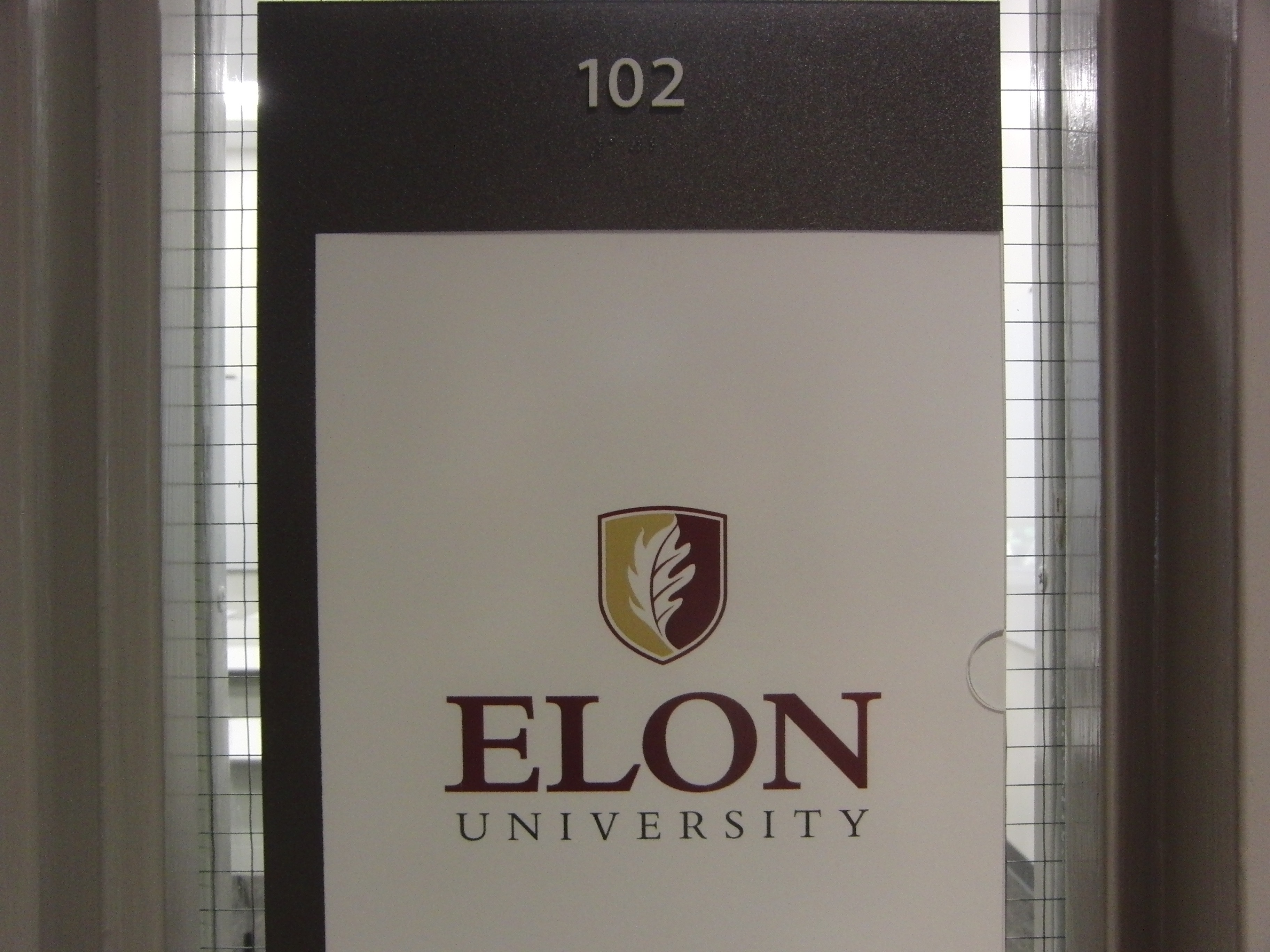 Photo of Long 102 room number and information sign