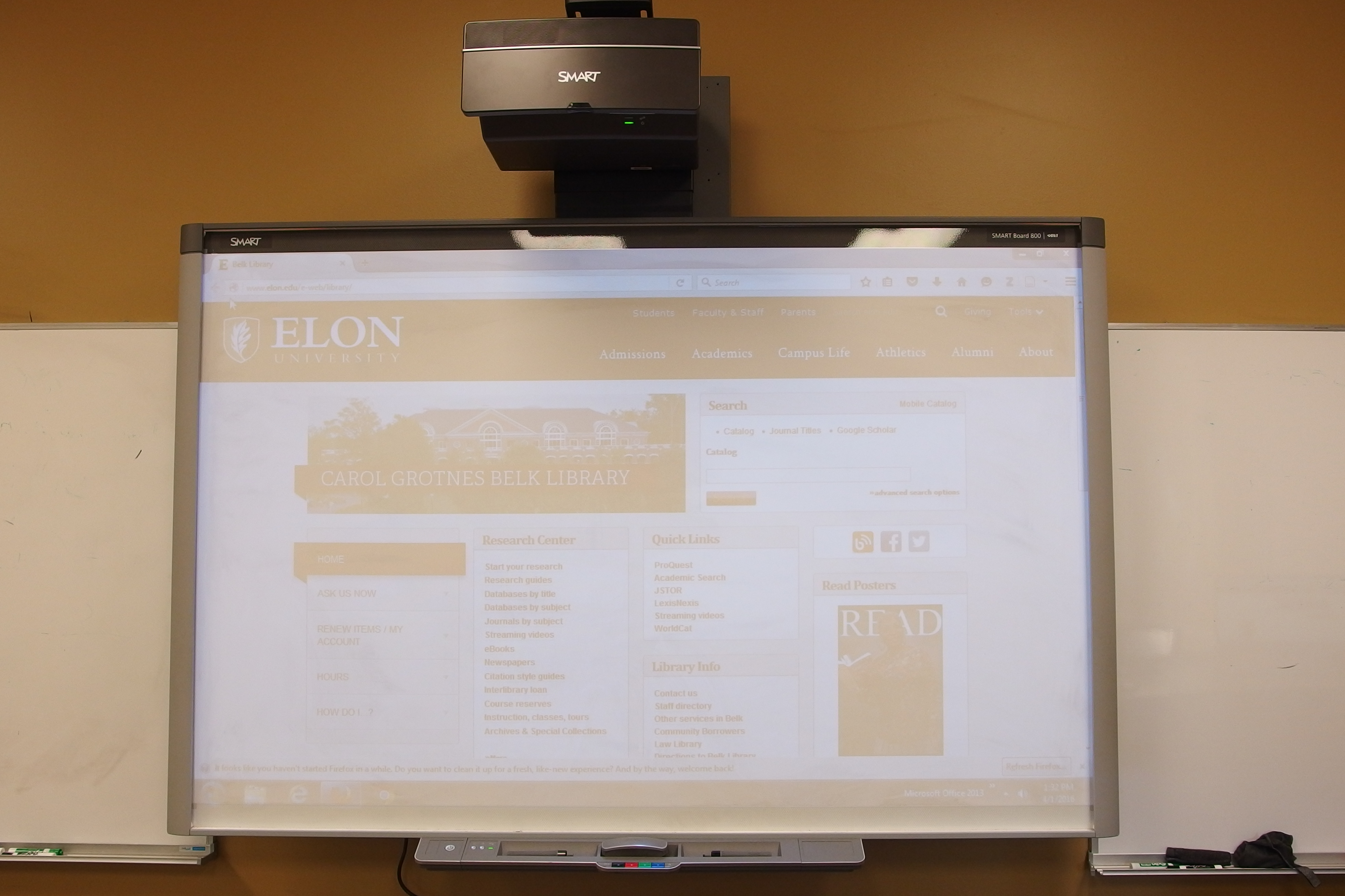 Photo of SMART branded smart board with attached pen tray and eraser