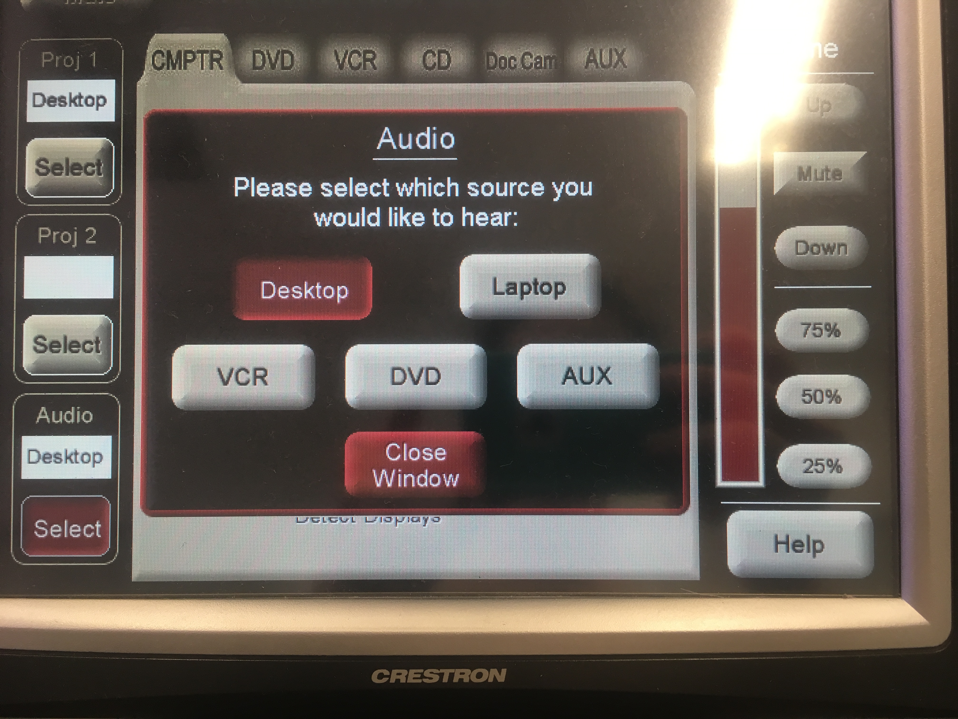 Photo of crestron control touch panel with computer tab active audio options for the projection system