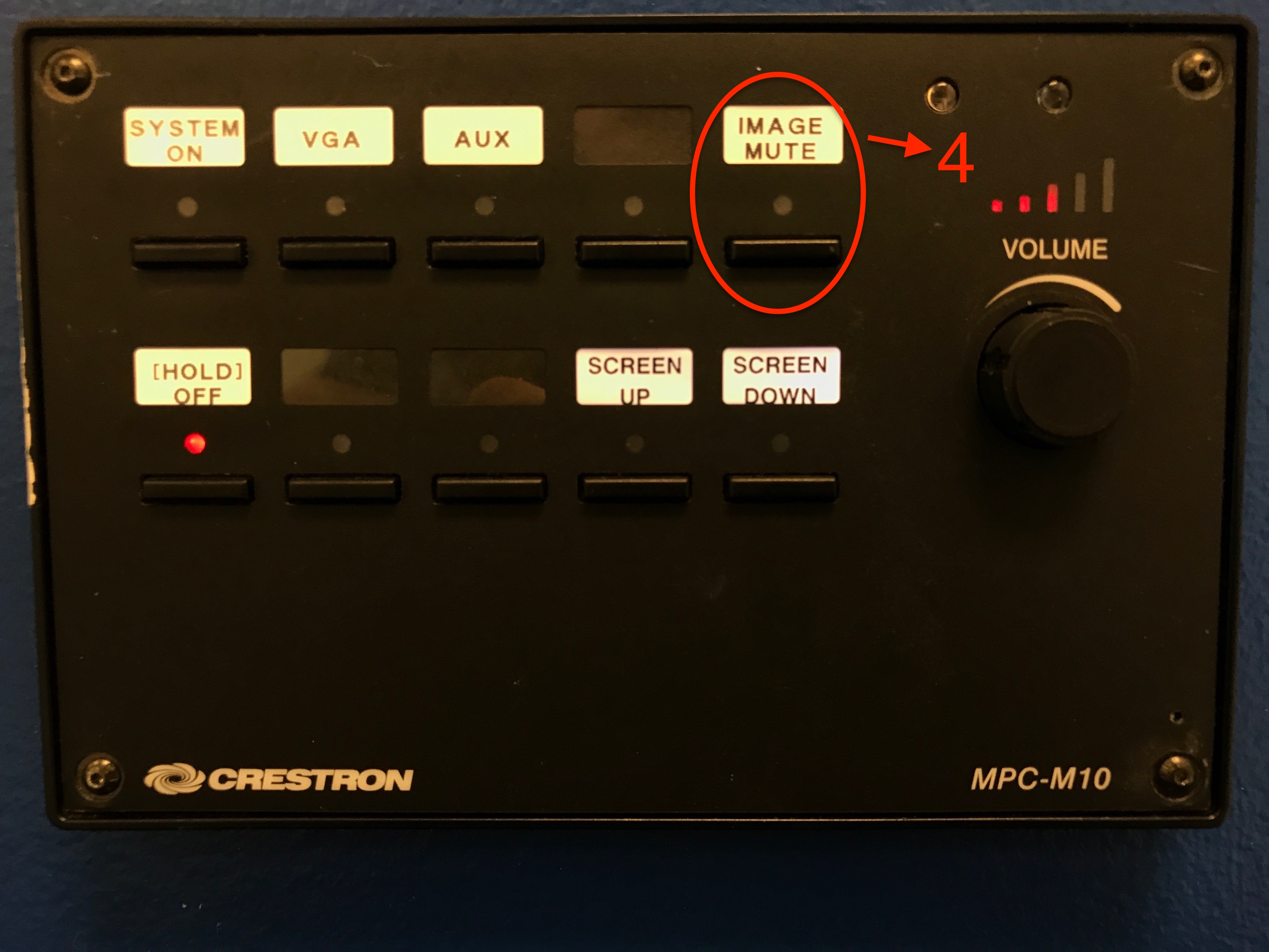 A photo of the 'image mute' button on the control panel.