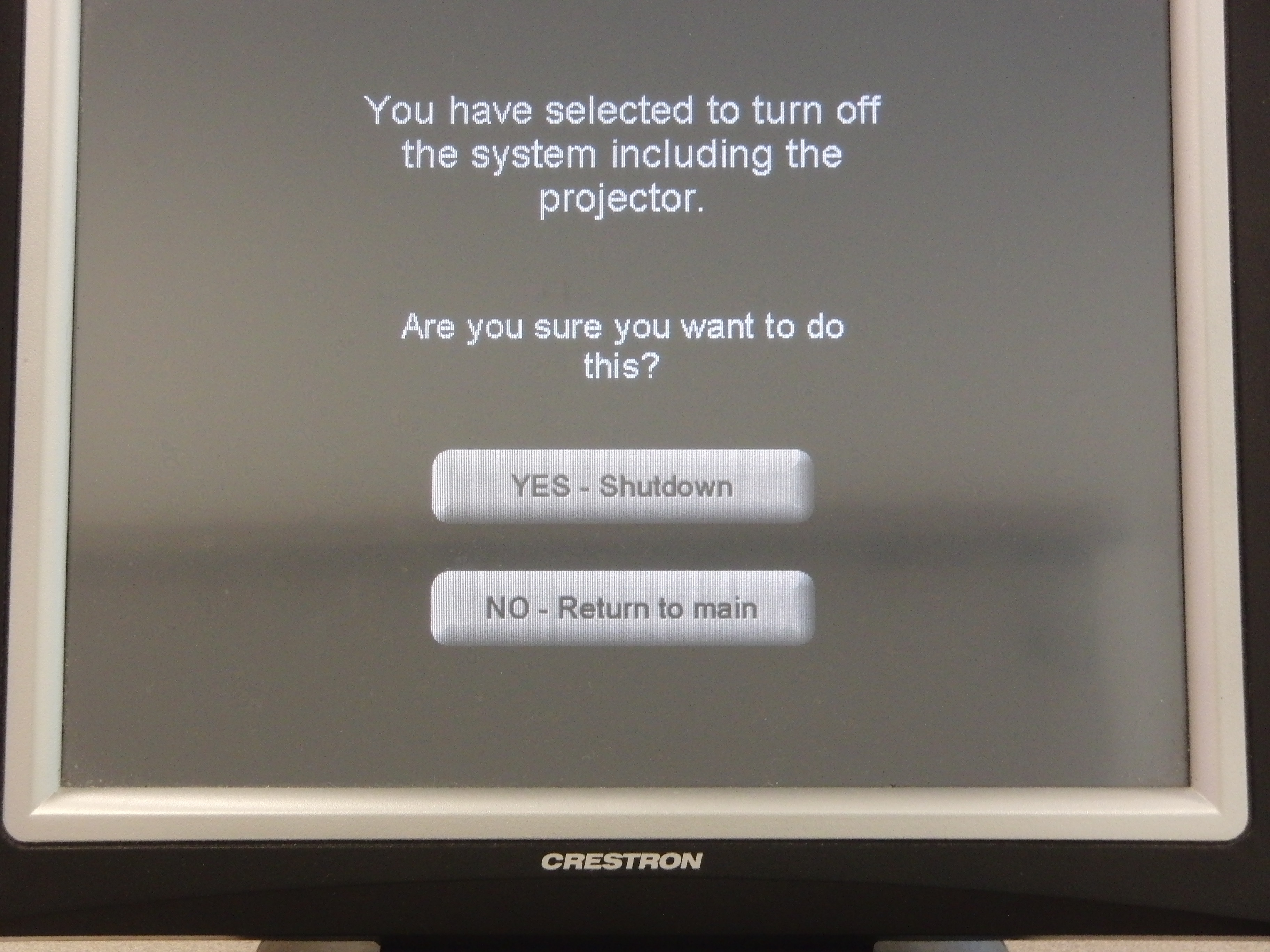 Photo of crestron control touch panel showing the shutdown screen