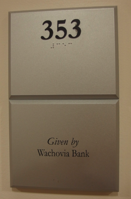 Photo of Koury Business Center 353 room number with dedication plaque below
