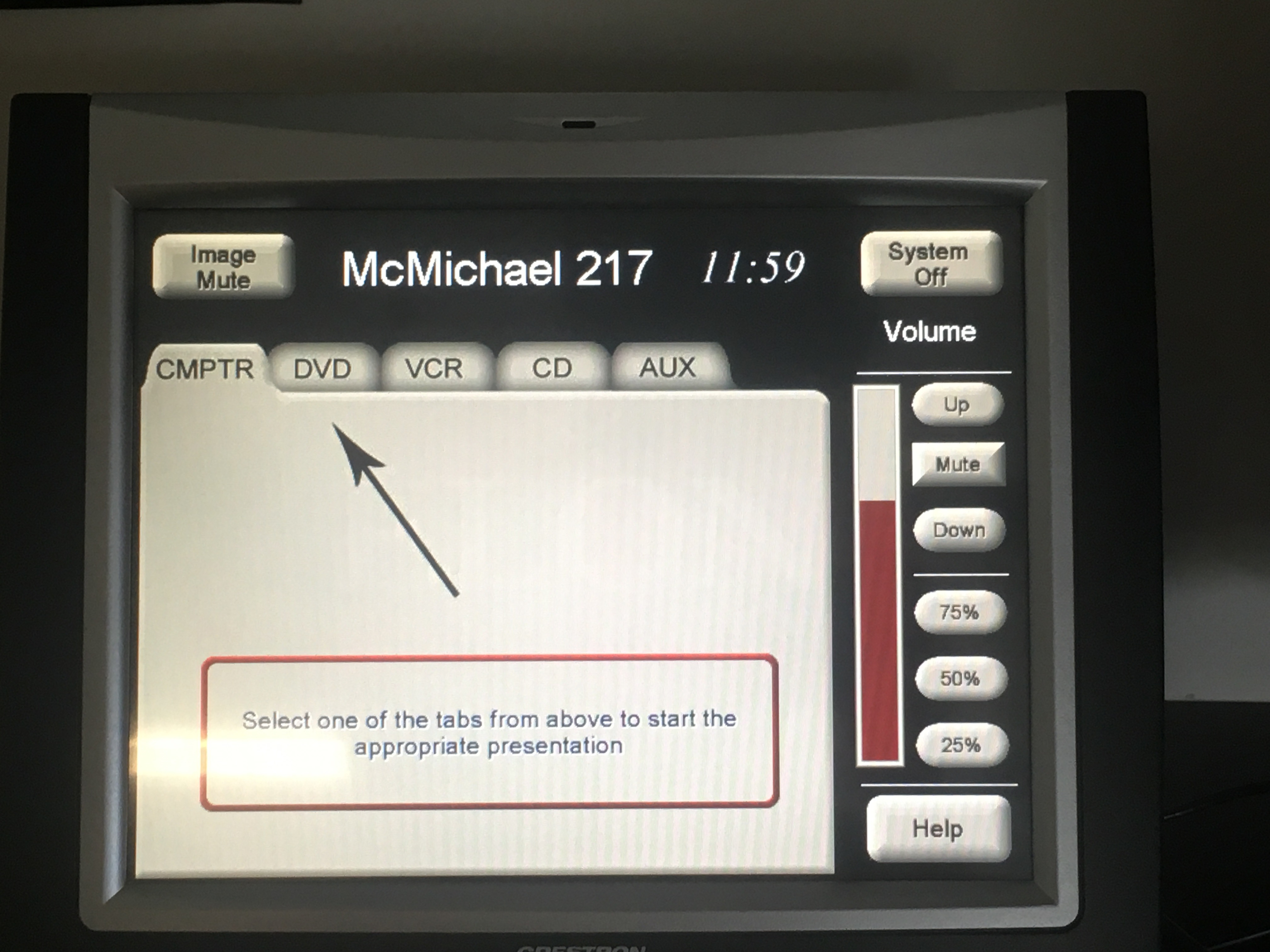 Photo of the crestron control touch panel with the computer tab active