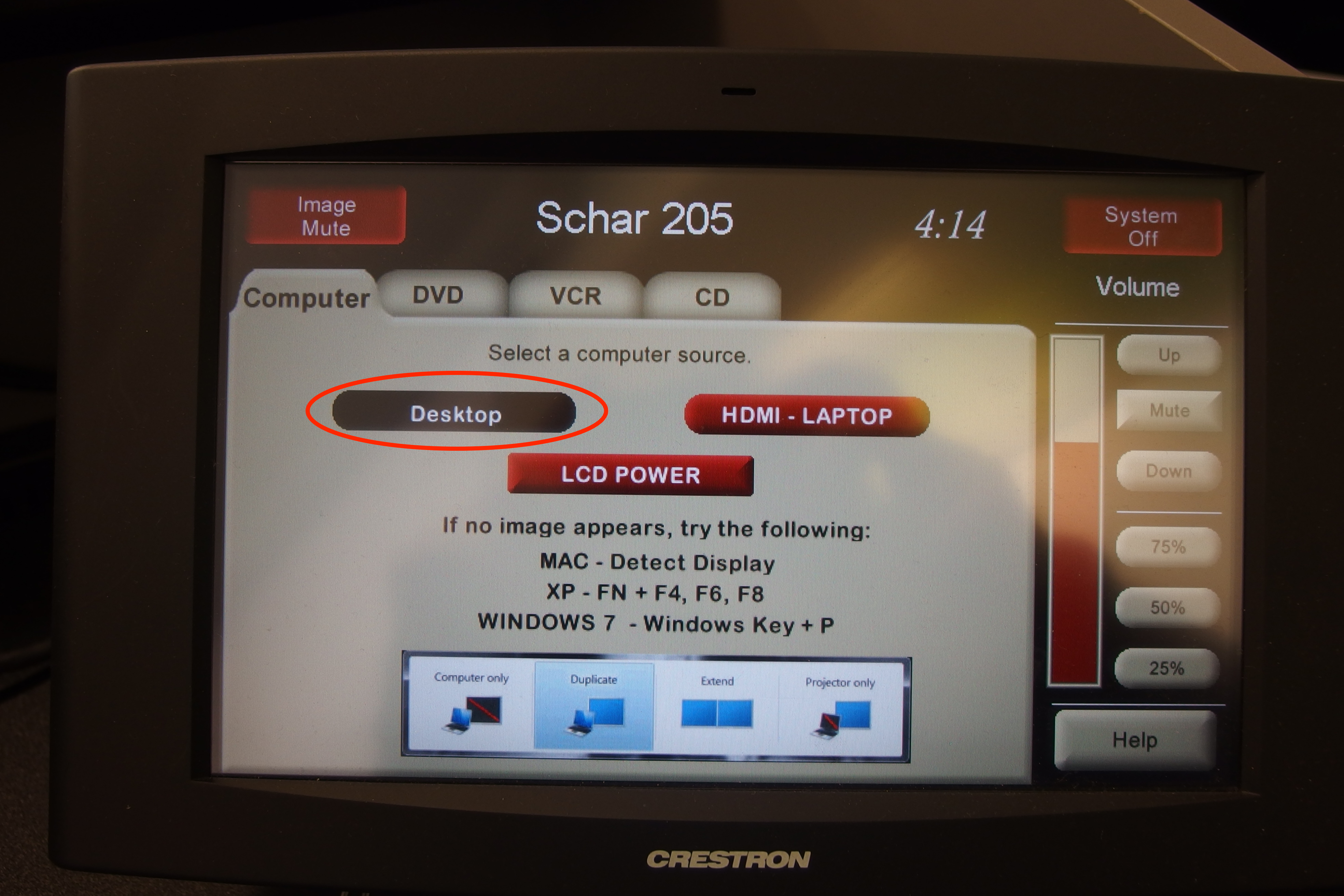 A photo of the touch panel with the desktop selection circled.
