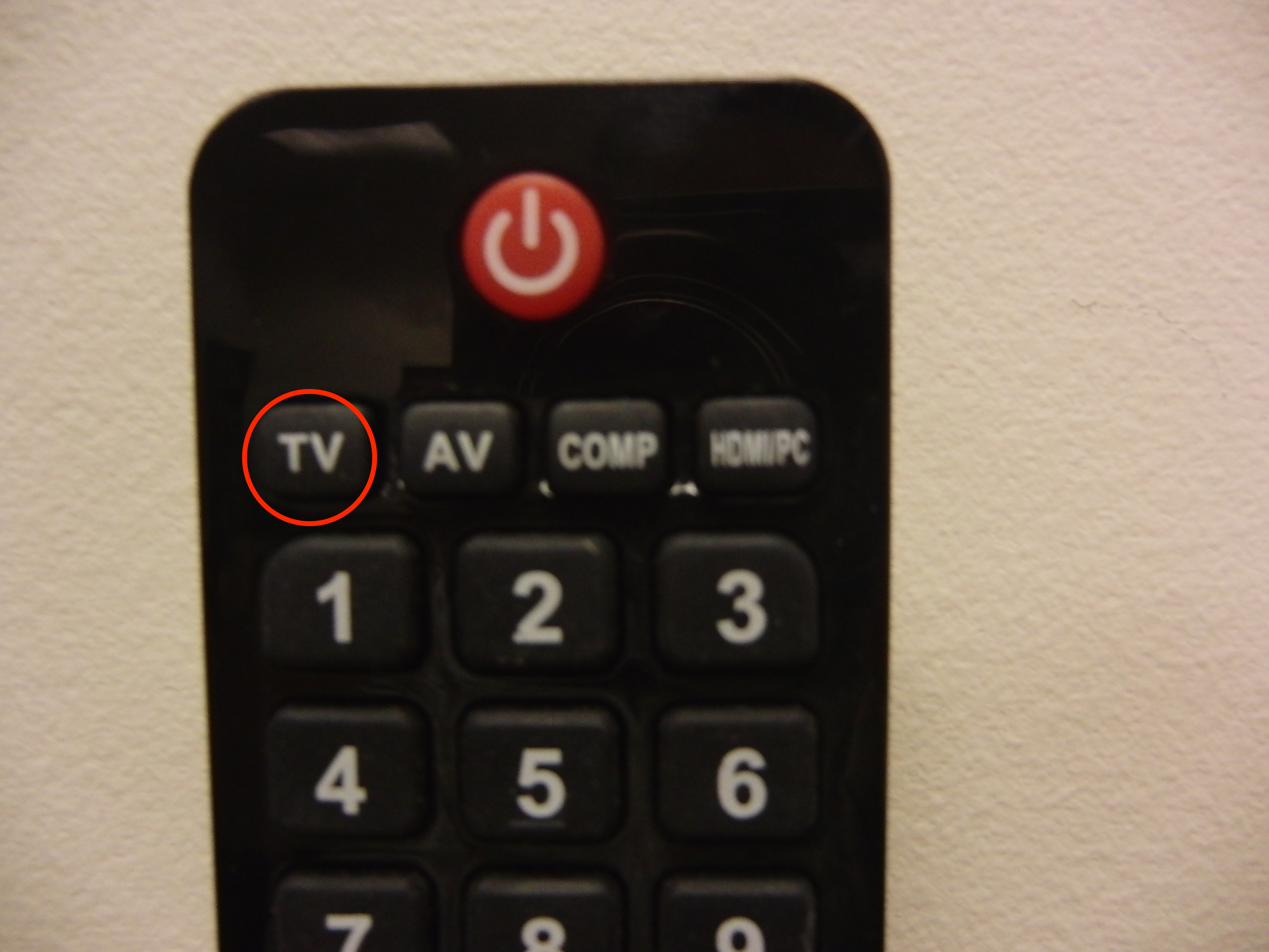 Photo of the top of the tv remote with the tv option highlighted