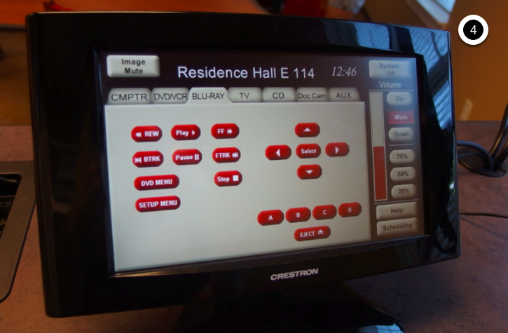 Photo of crestron control touch panel with Blu-Ray tab active
