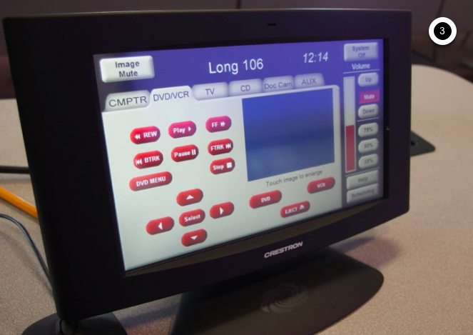 Photo of crestron control touch panel with the dvd/vcr tab active