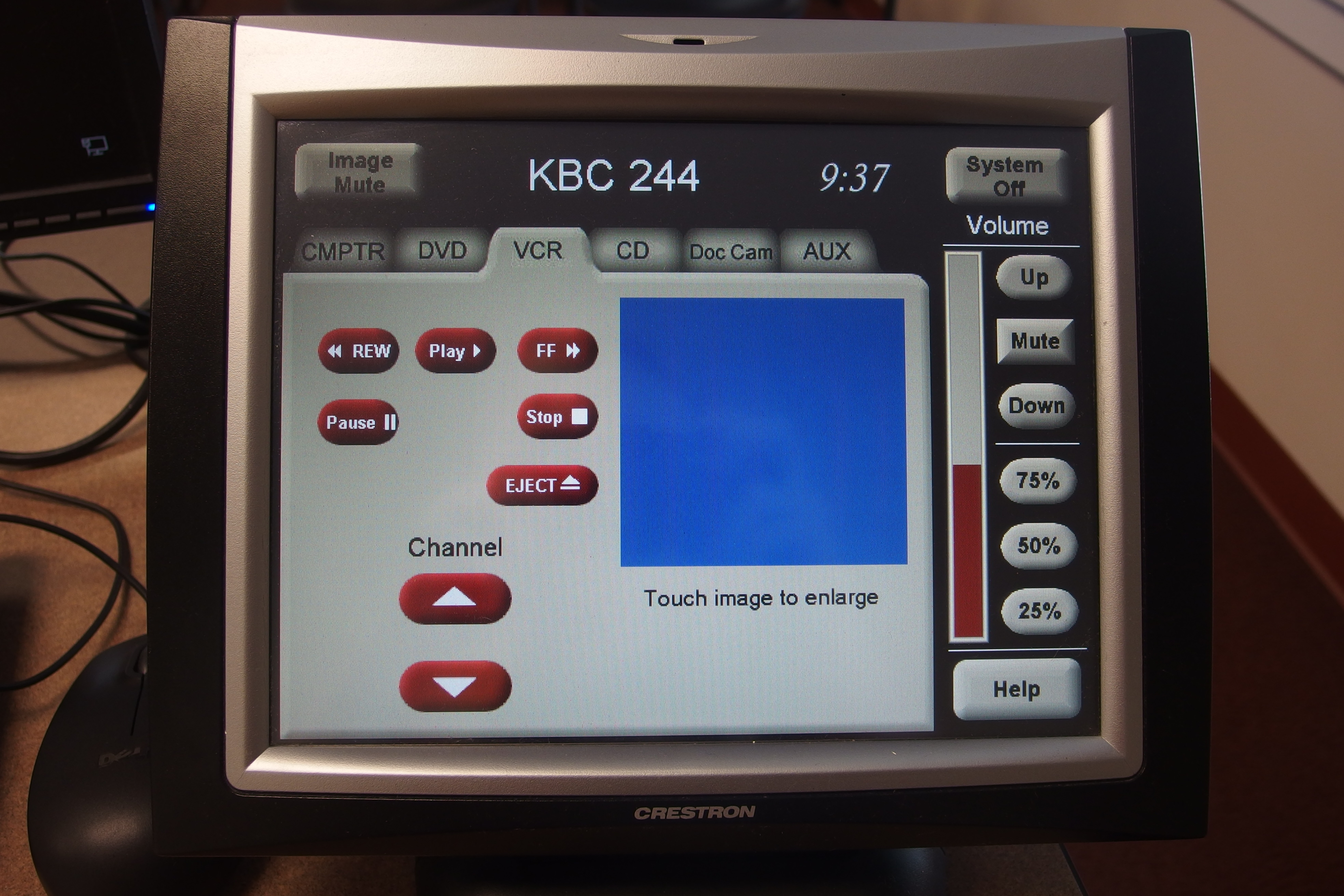 Photo of crestron control touch panel with the vcr tab active