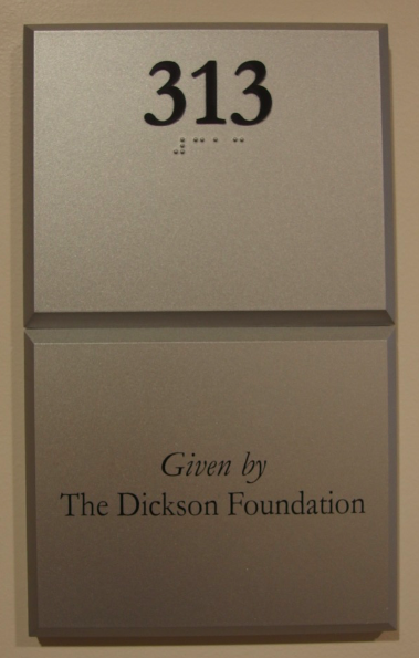 Photo of Koury Business Center 313 room number with dedication plaque below