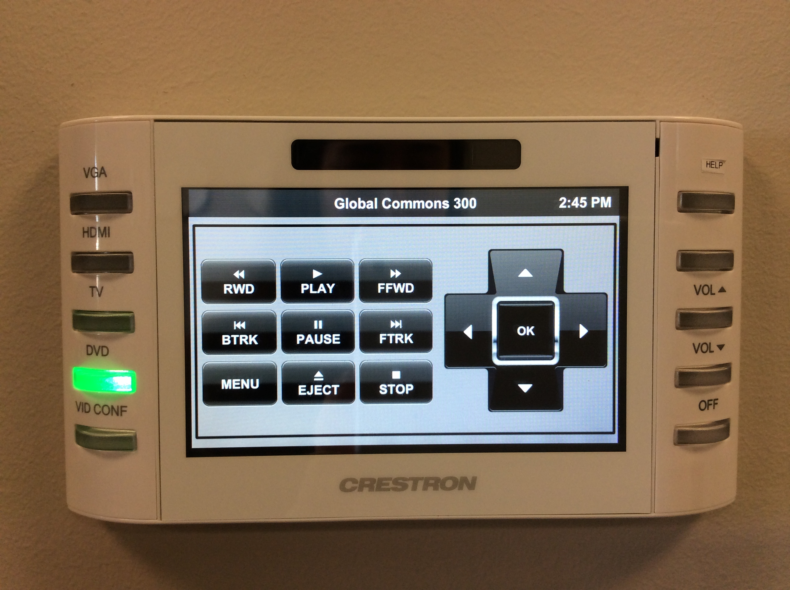 Photo of crestron control touch panel with dvd option active